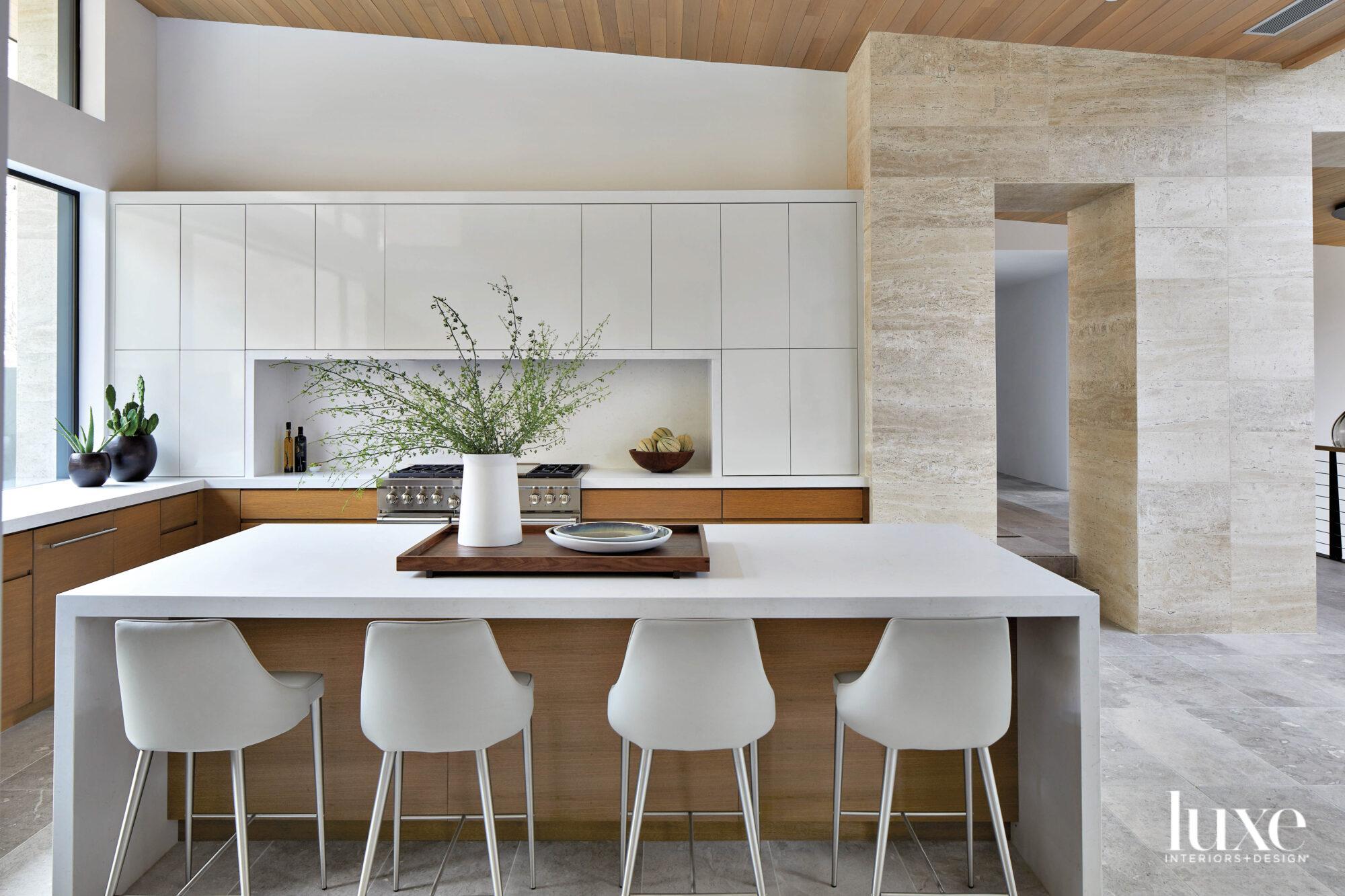 A minimalist kitchen with white...