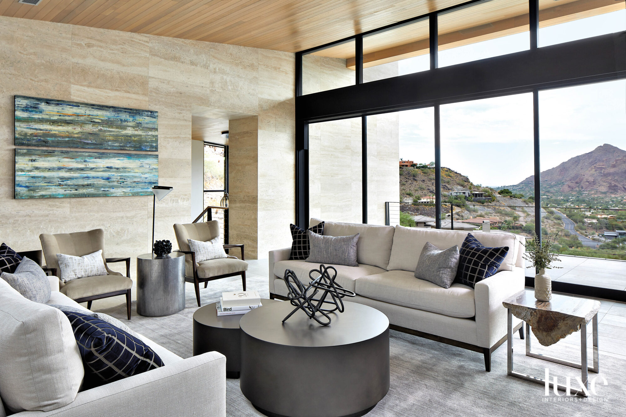 A living room with neutral...