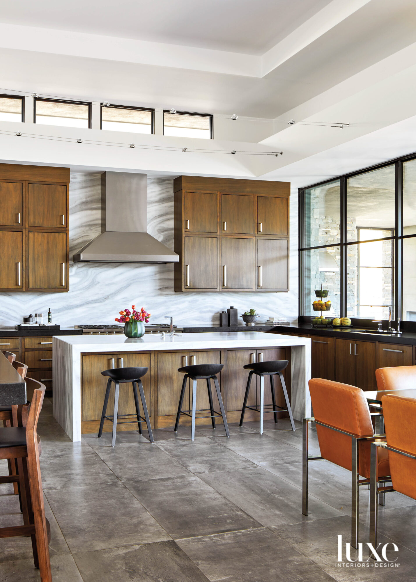A modern kitchen with marble...