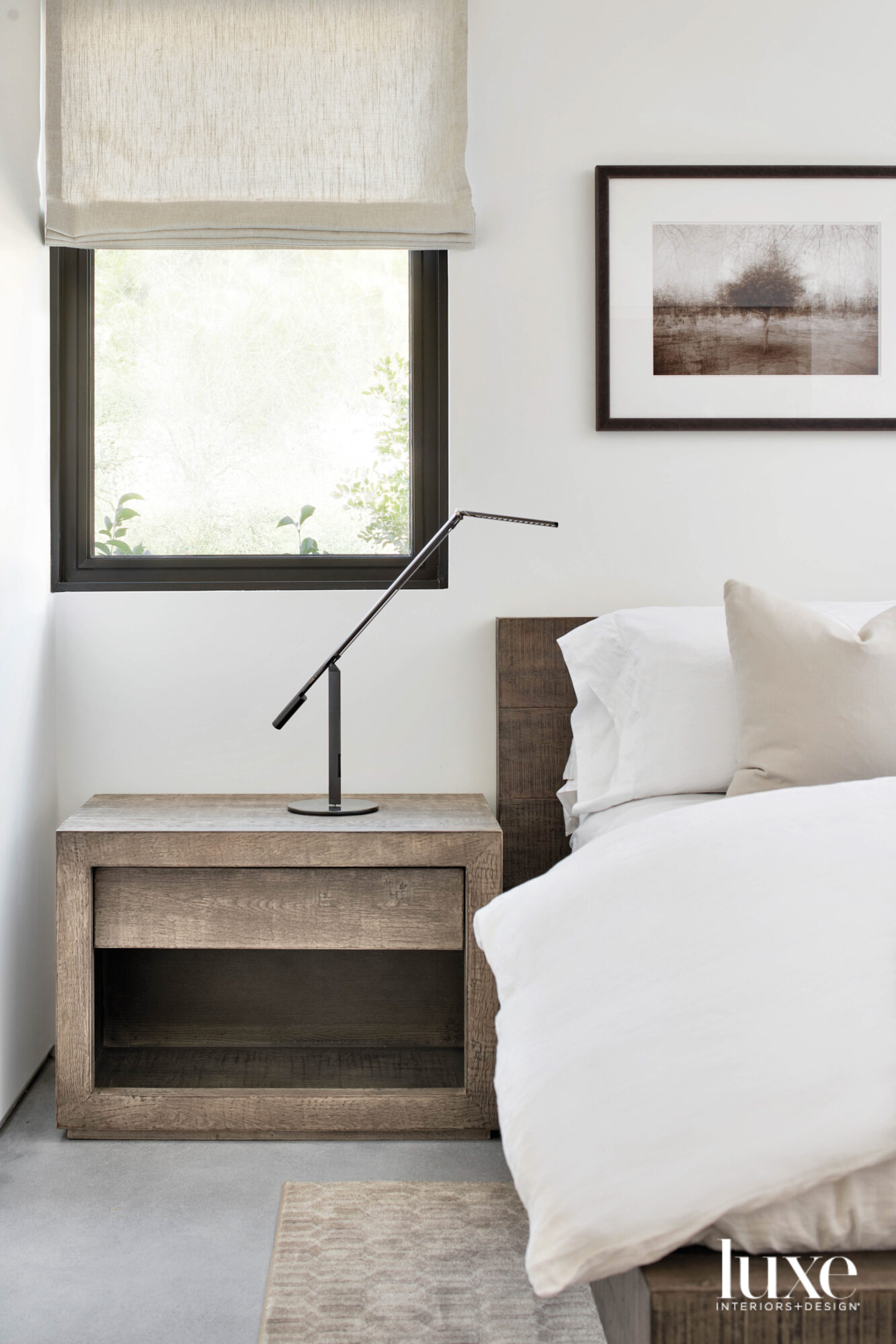 A neutral bedroom with a...