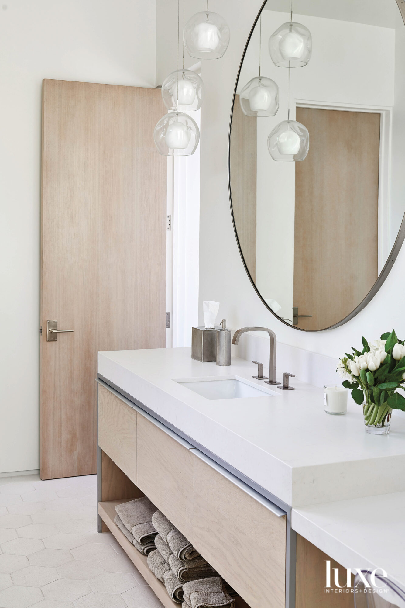 A bathroom vanity with white...
