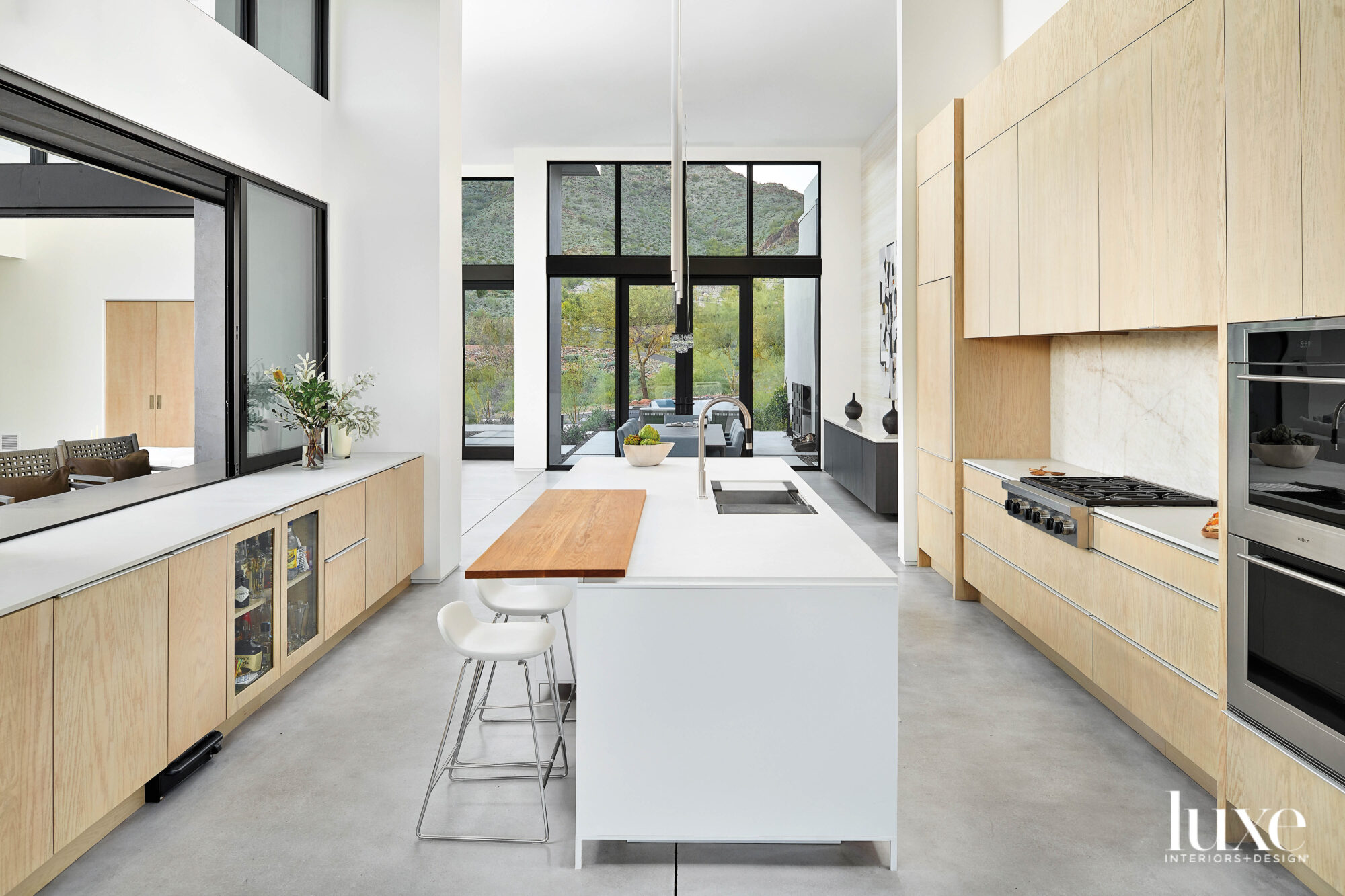 A modern kitchen with white-oak...