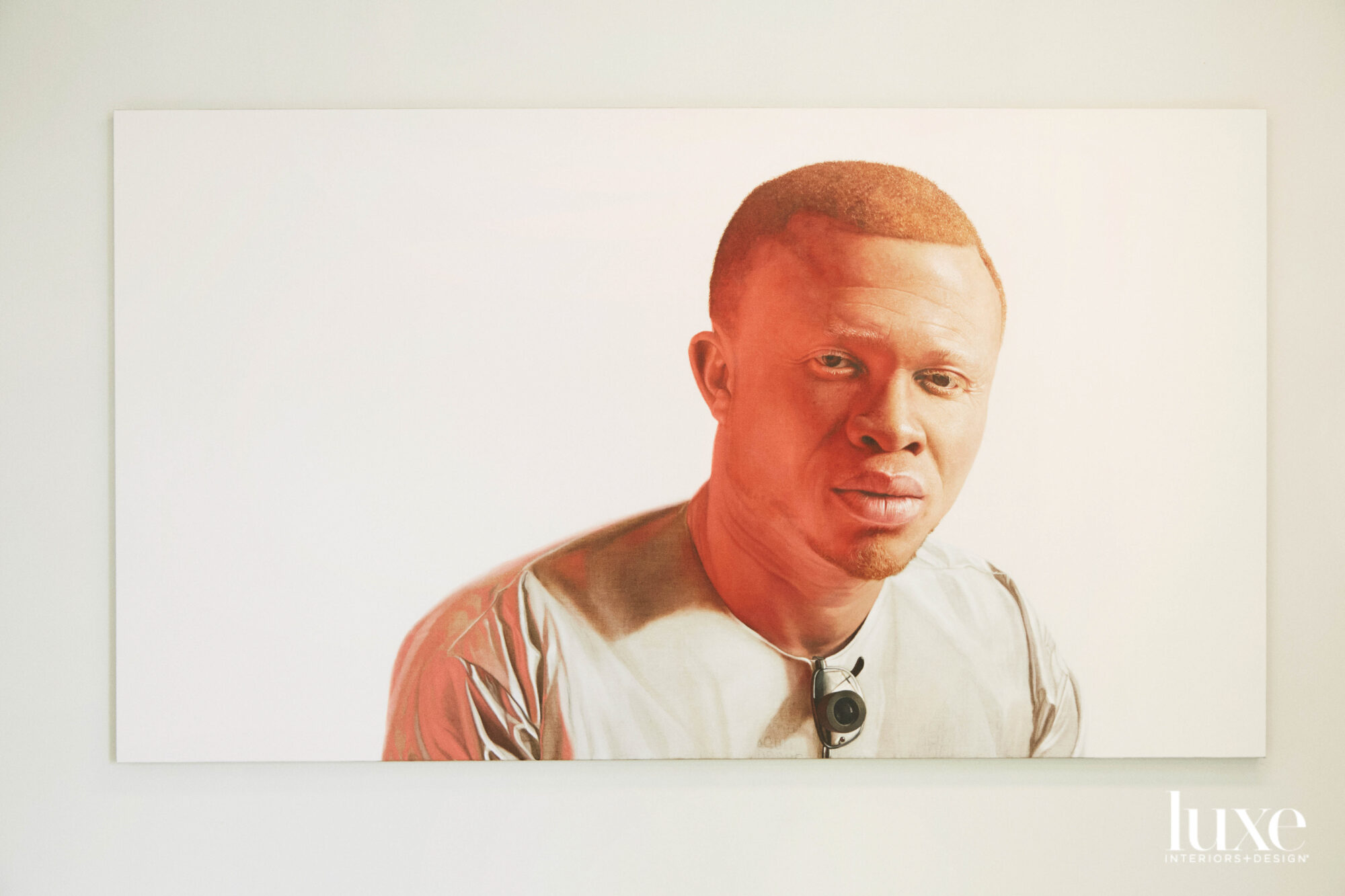 A painting of a Black main in a pale t-shirt.