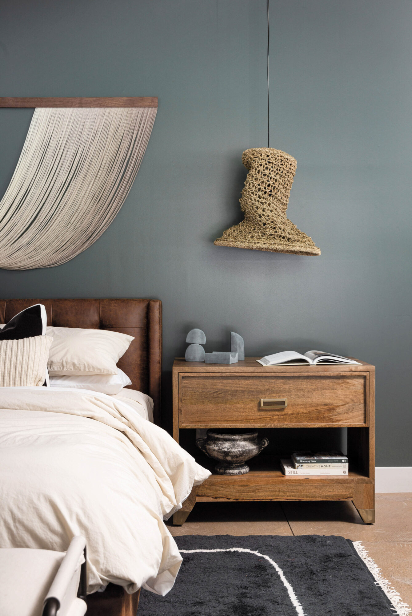 bedroom with white sheets blue walls