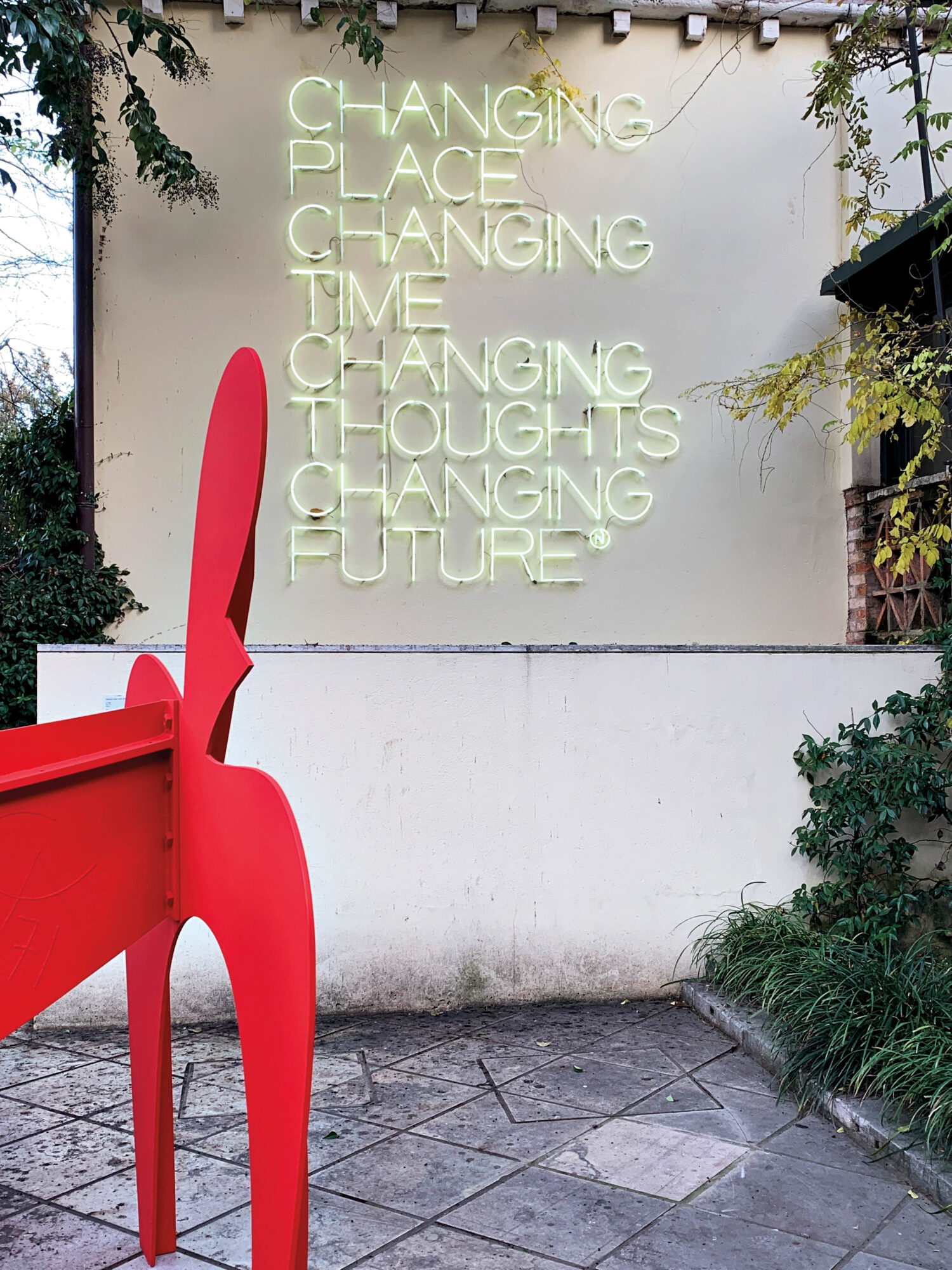 artwork and neon sign of quote