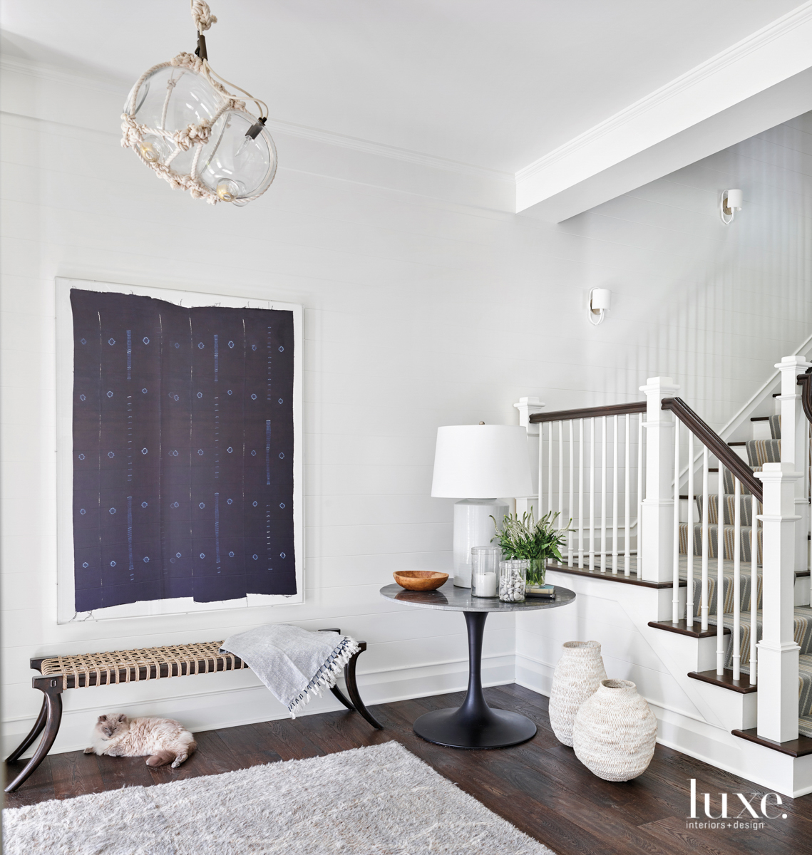 white entry with wood floors
