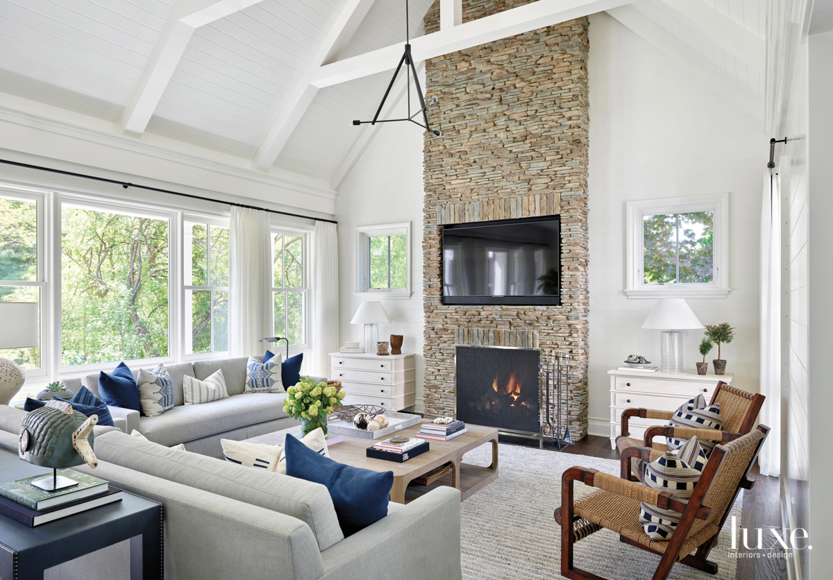 great room with brick fireplace