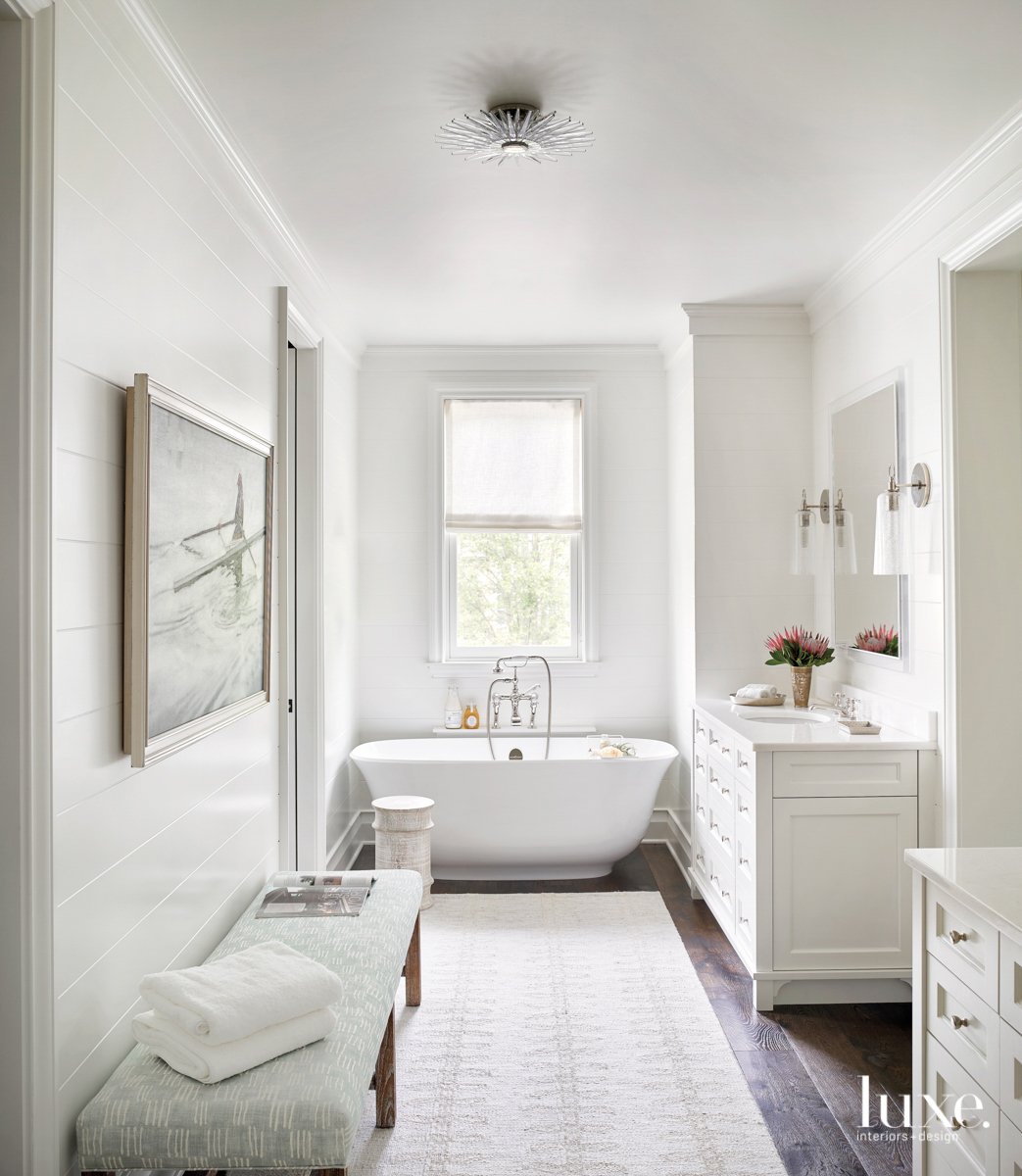 white master bedroom with soaking...