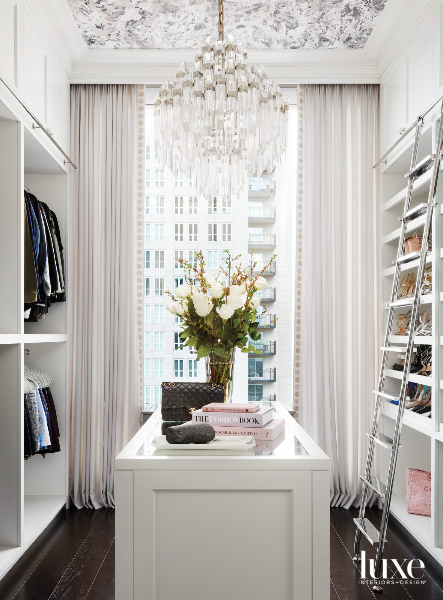 A women's closet with a...