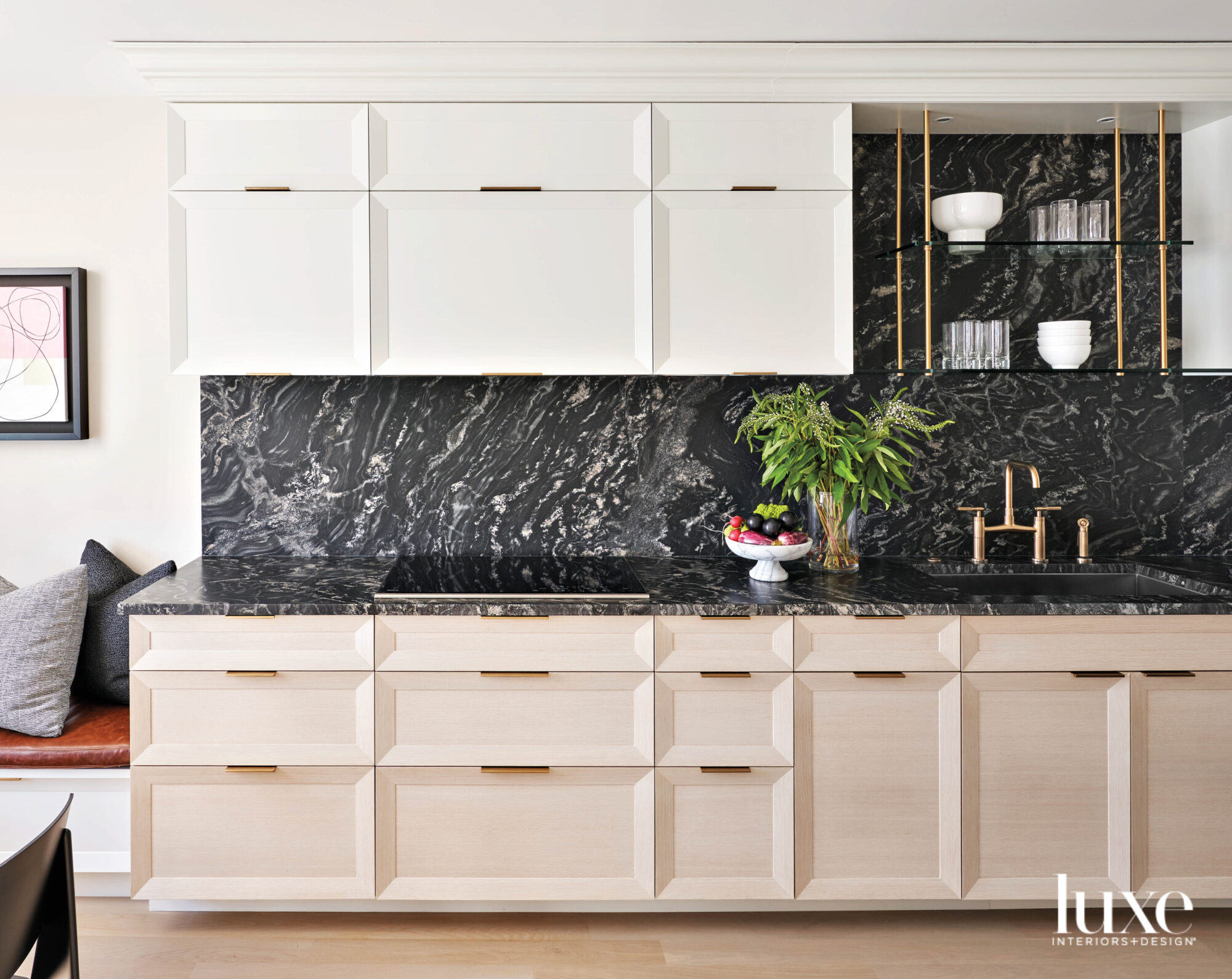 A kitchen with black marble...