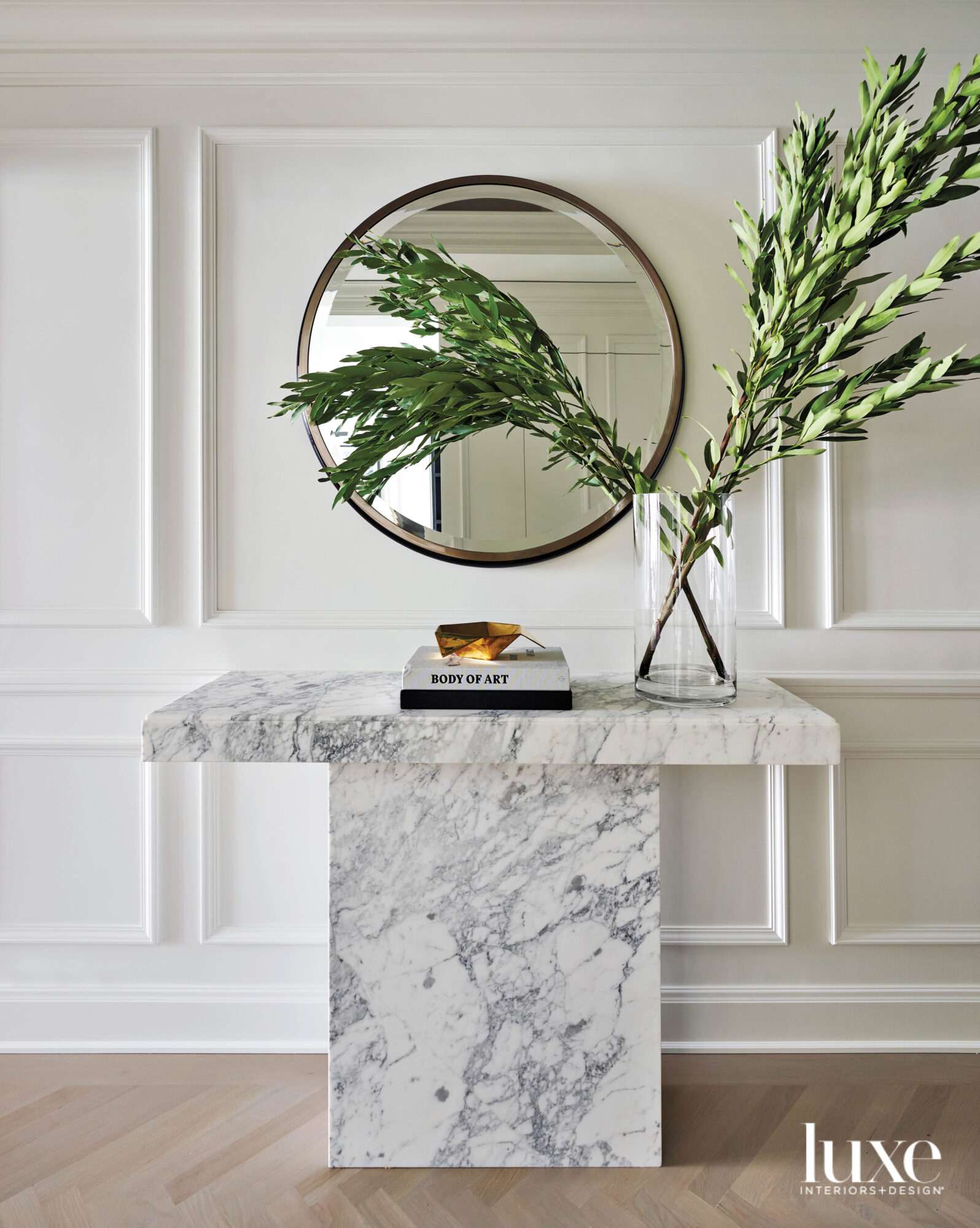 A marble console with a...