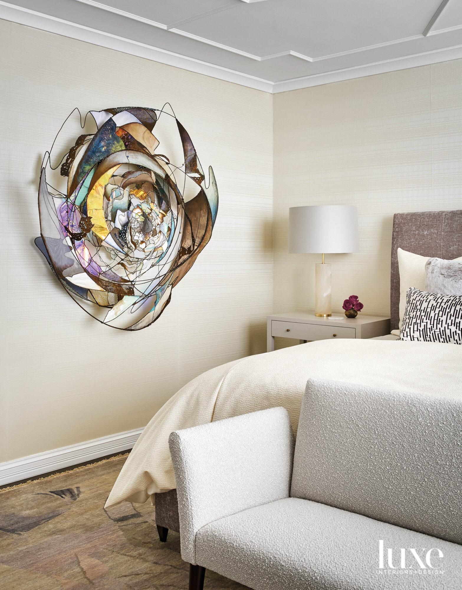 A multi-color round sculpture hangs...