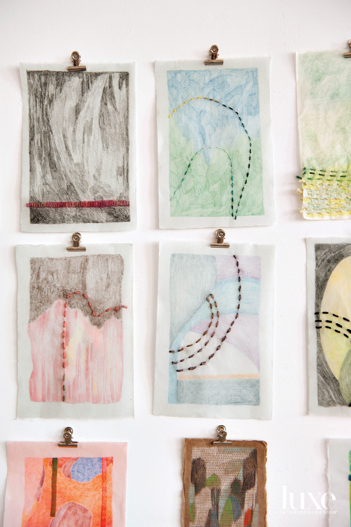Nine small drawings with yarn stitched into the paper.