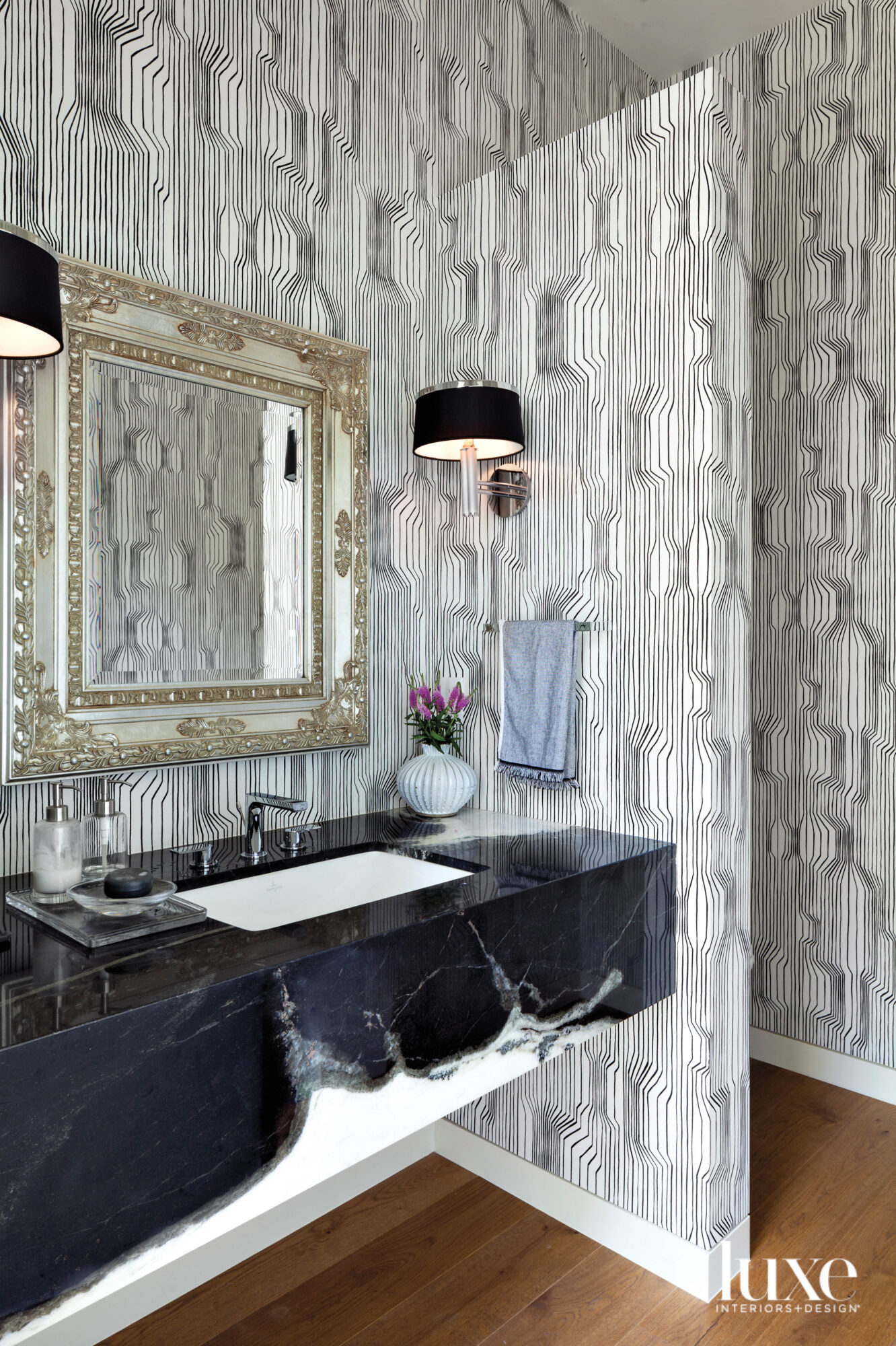 powder room with geometric black-and-white...