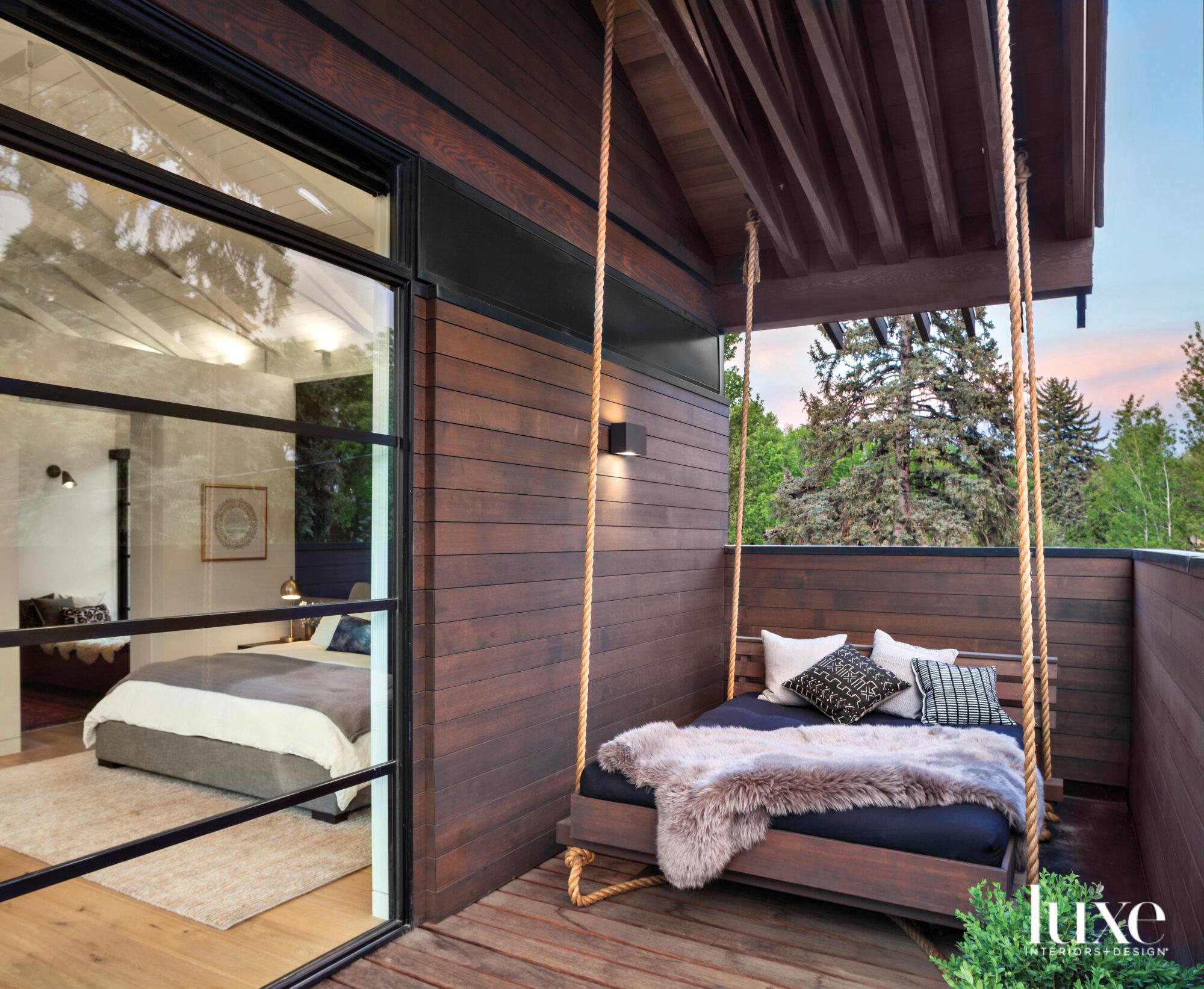 large swinging bed on balcony...