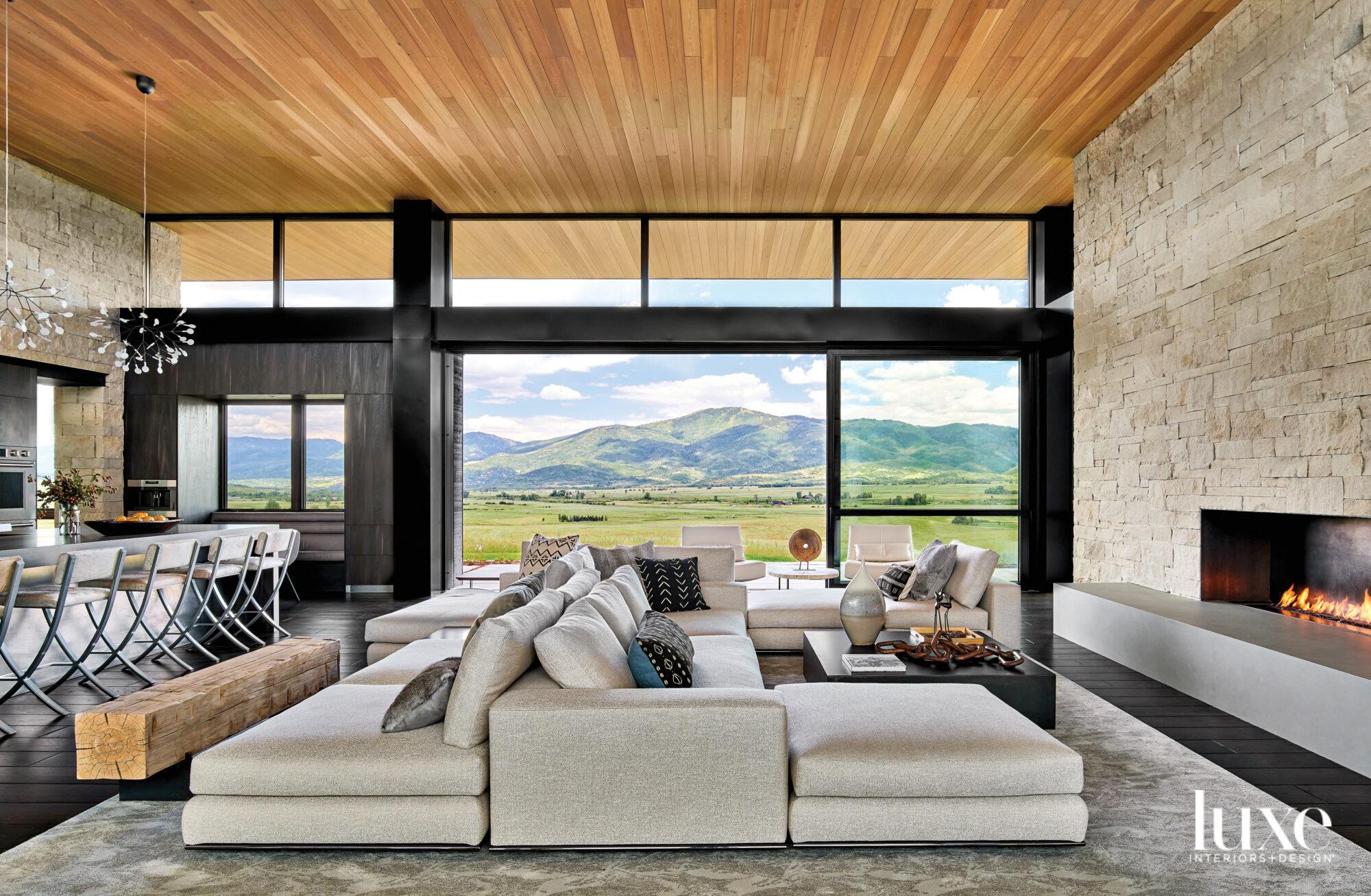 Tan modular sofa faces the...