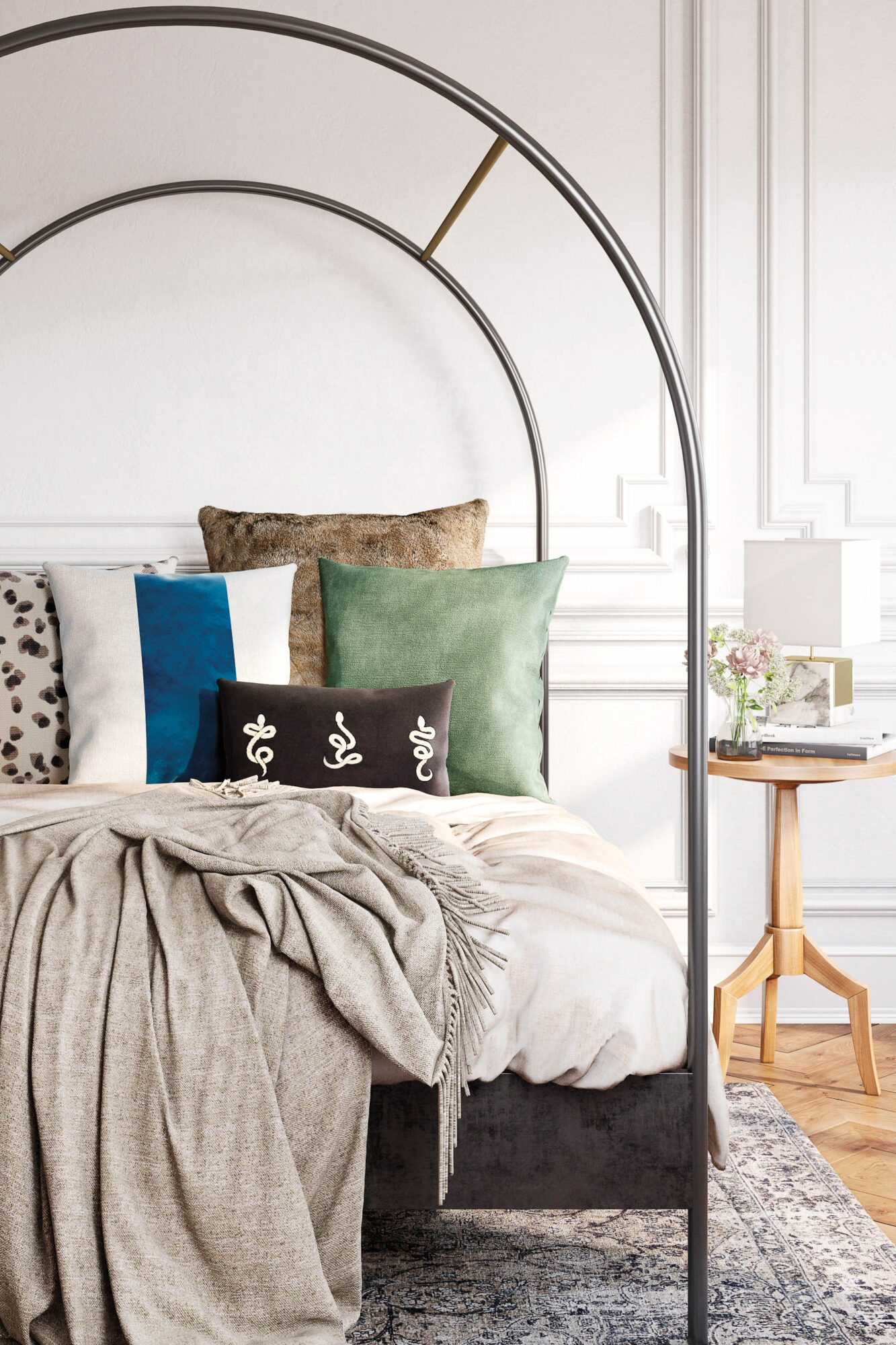 vignette of bed with cozy pillows