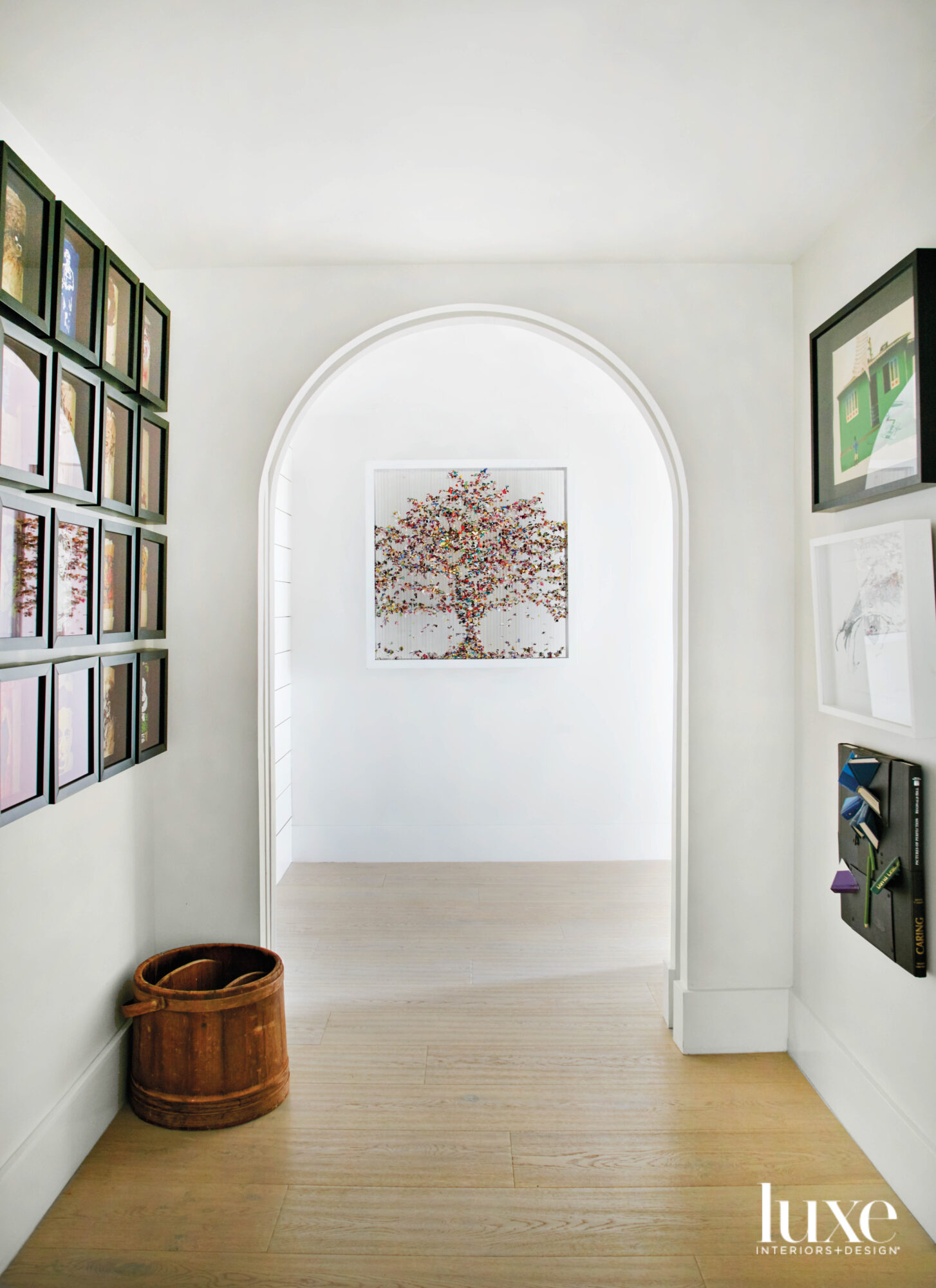 white hallway with curved archway,...