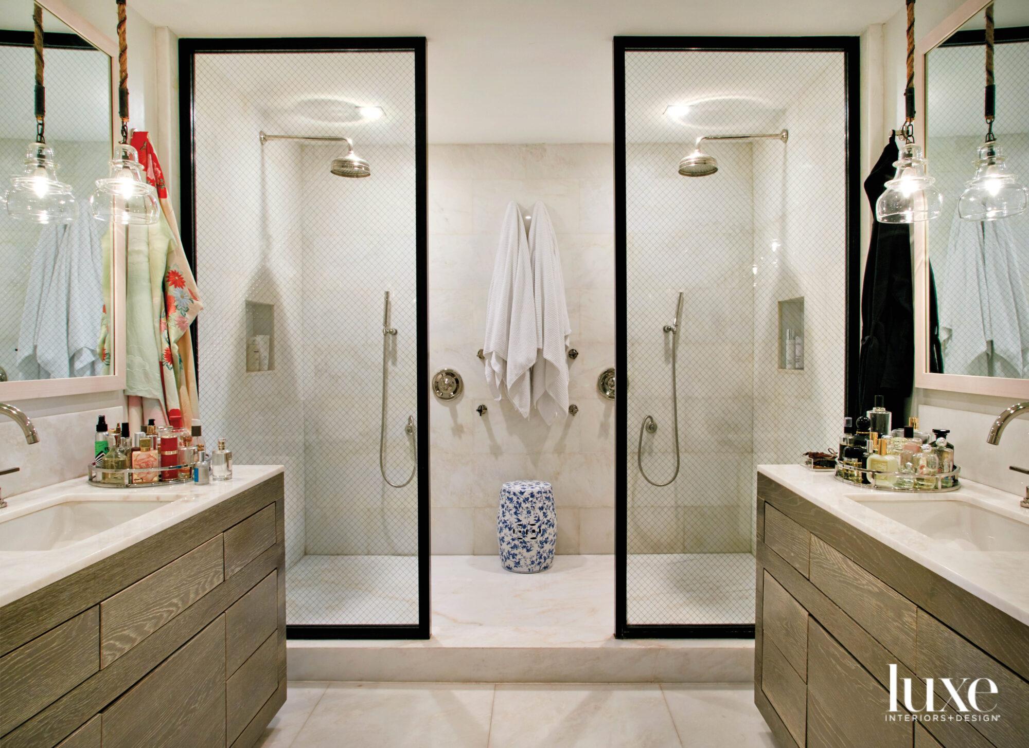bathroom with black-framed glass shower...
