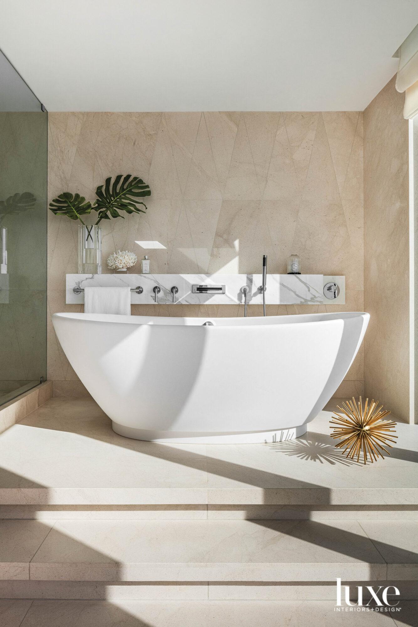 bathroom with freestanding white tub