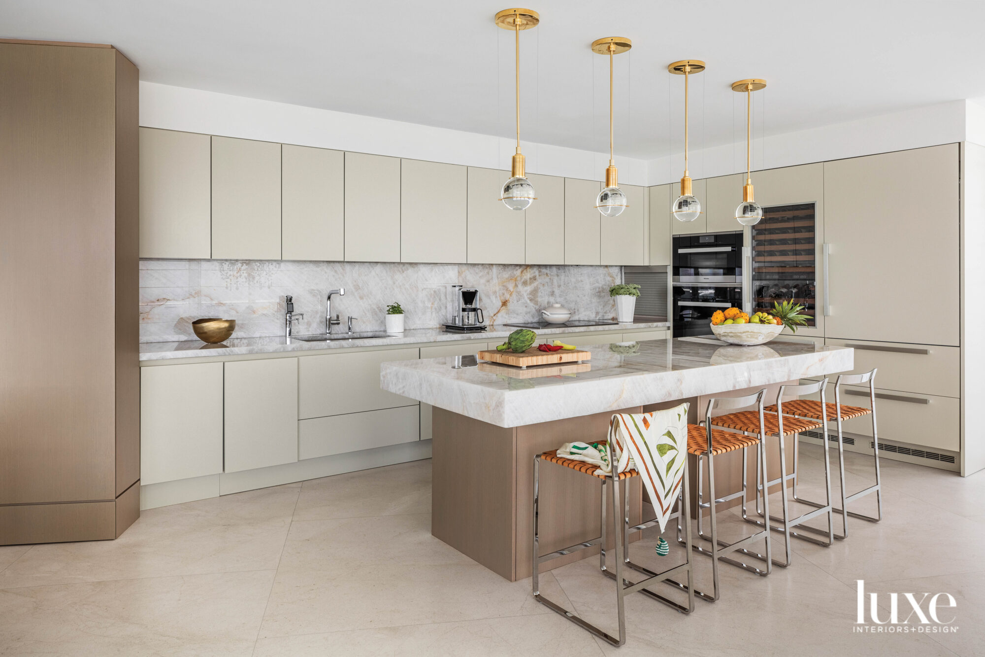 neutral-colored kitchen with island, bar...