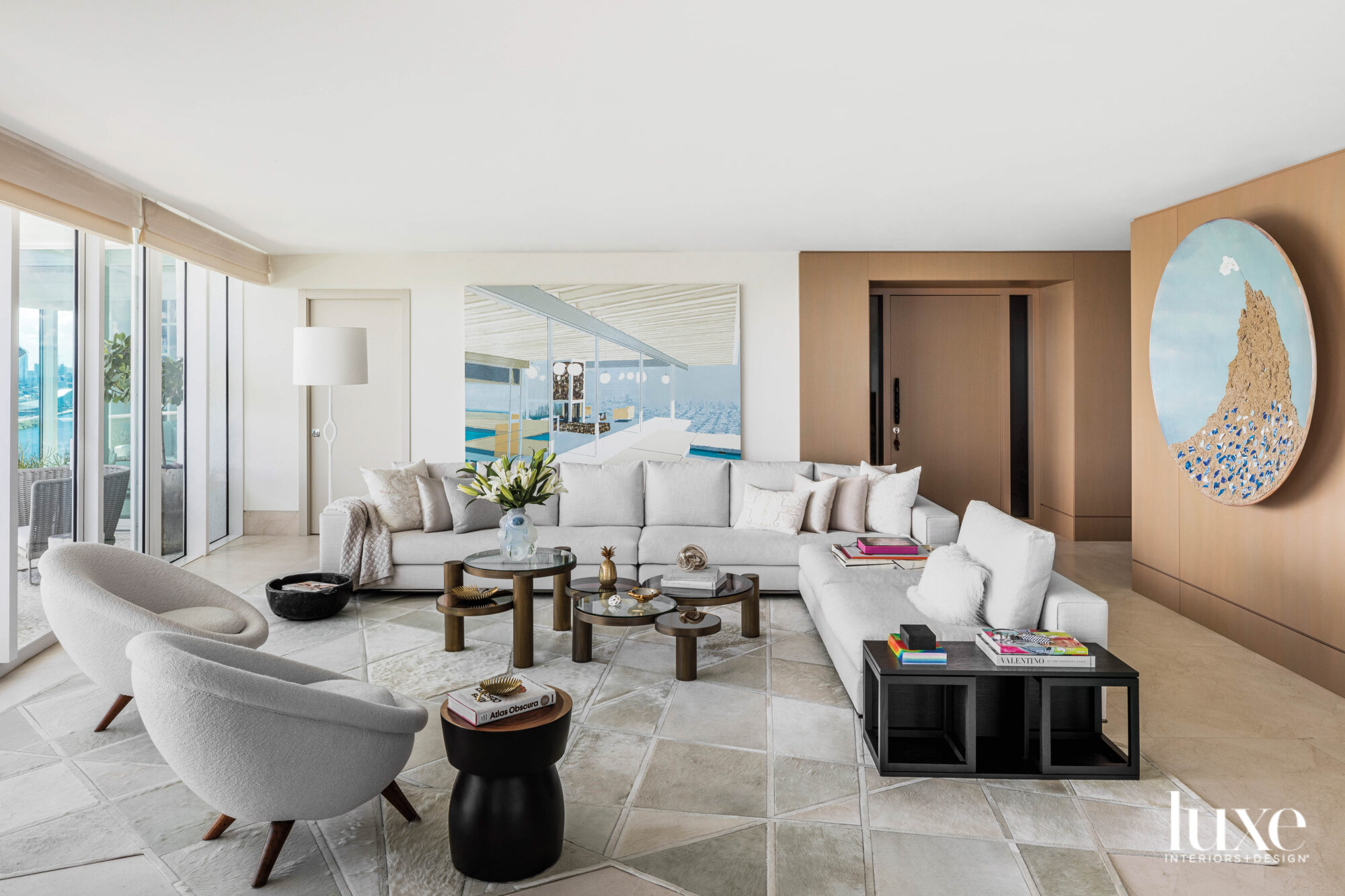 neutral-colored living area with white...