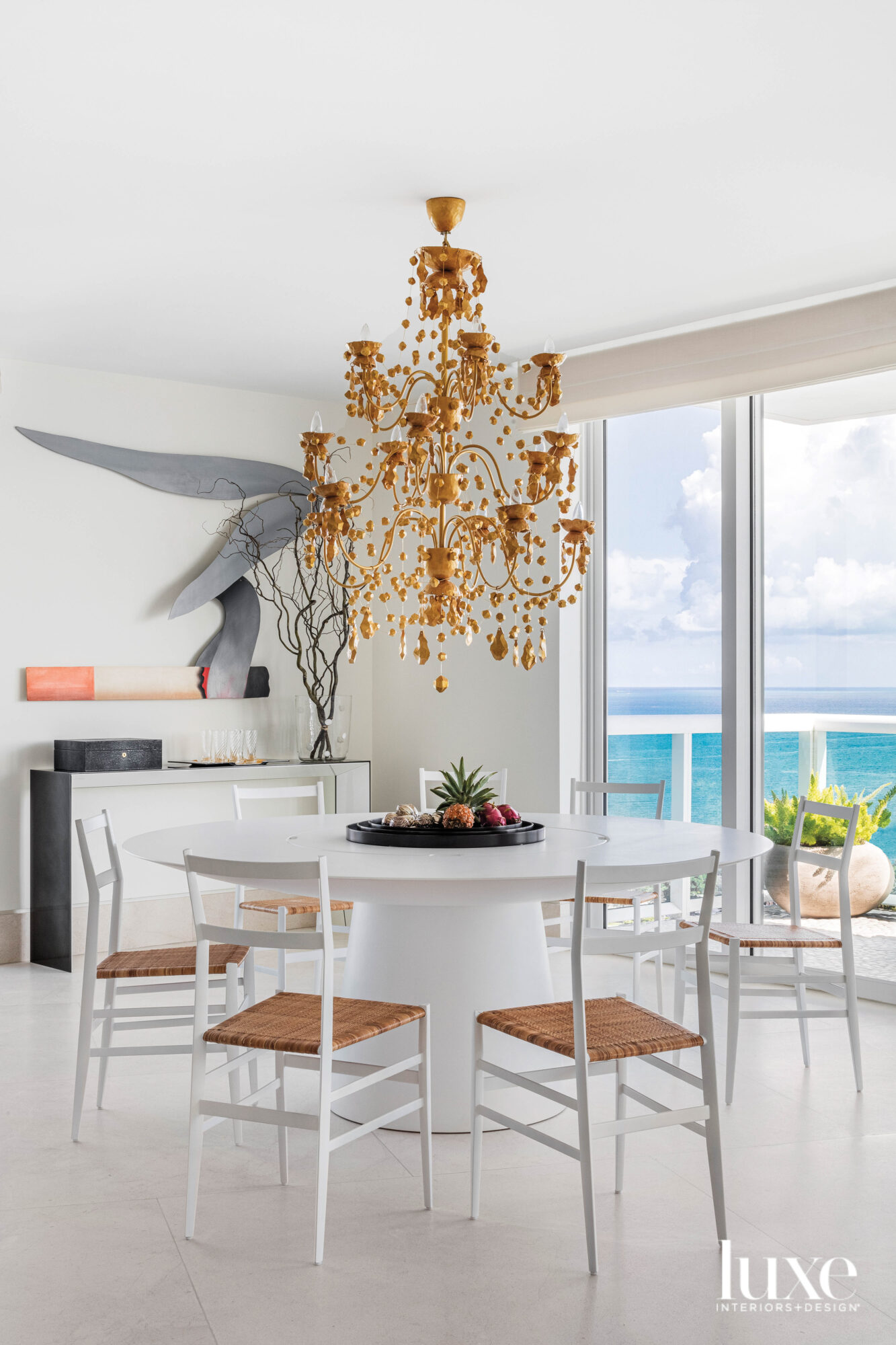 dining area with terra-cotta chandelier...