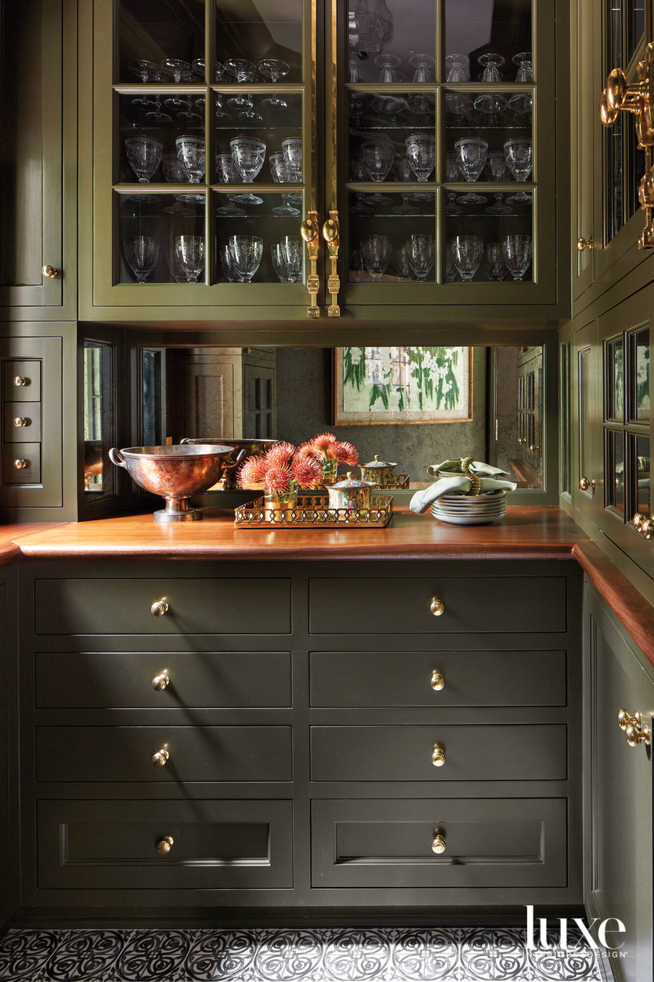green and wood pantry with flowers and barware