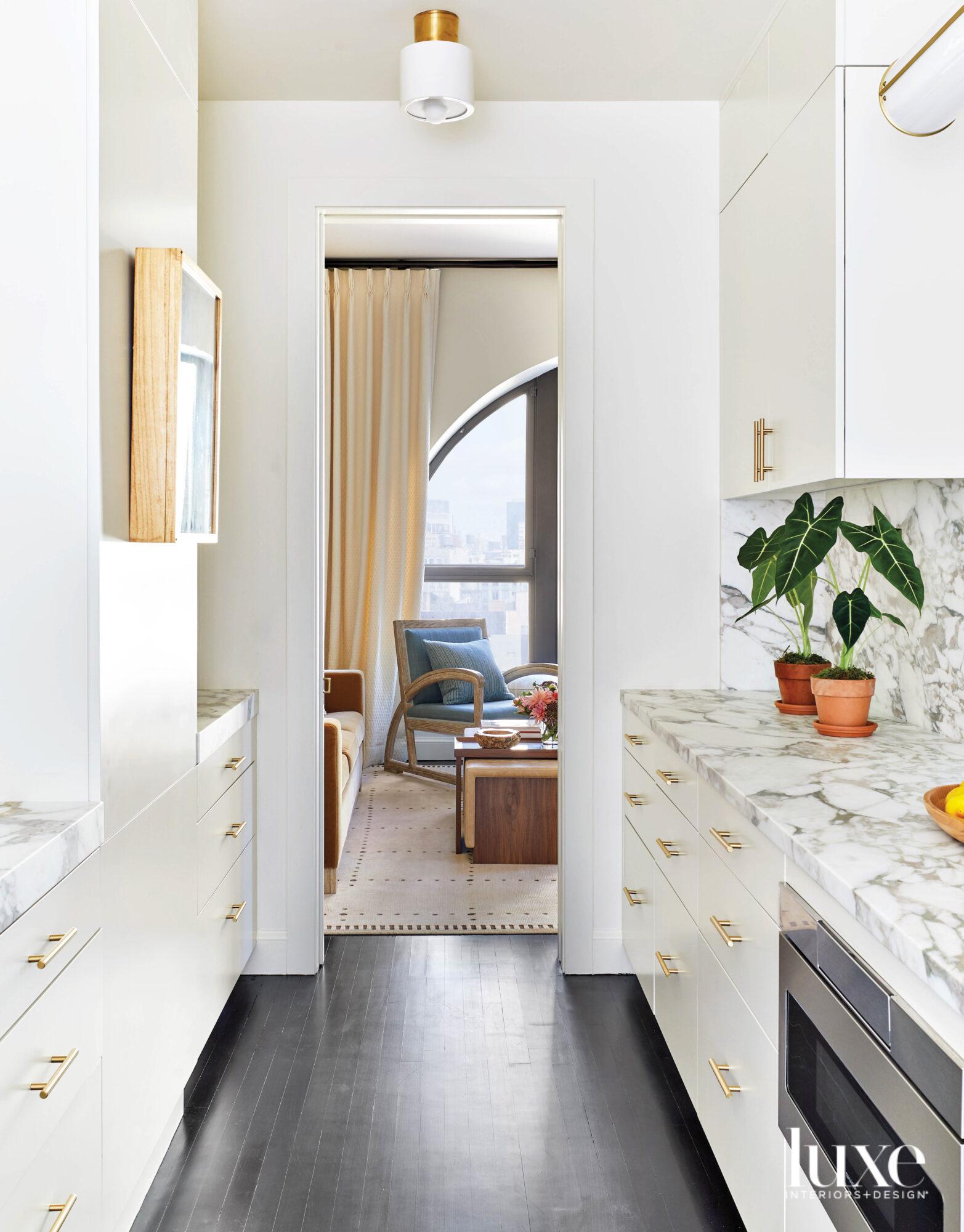 white kitchen with satin brass...