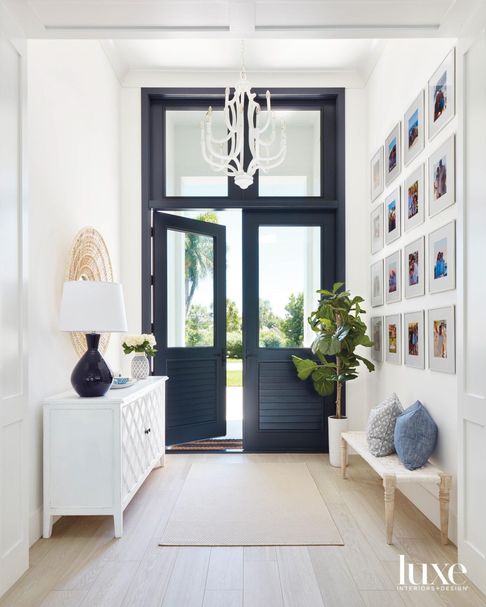 entryway with navy front door,...