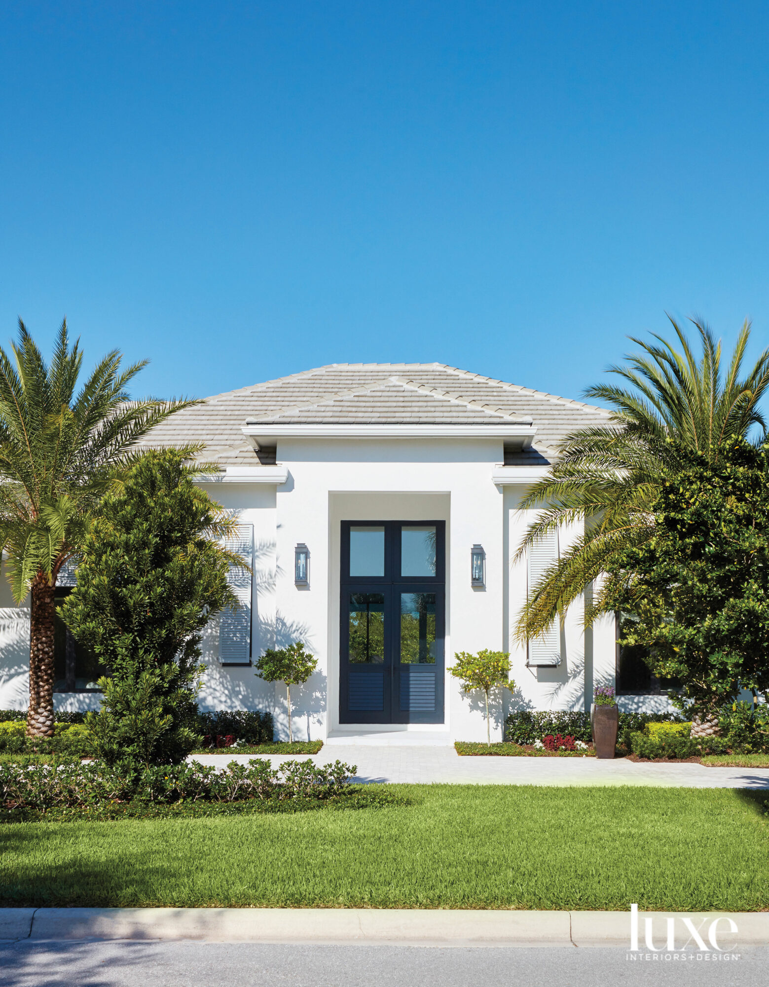 one-story house with white stucco...