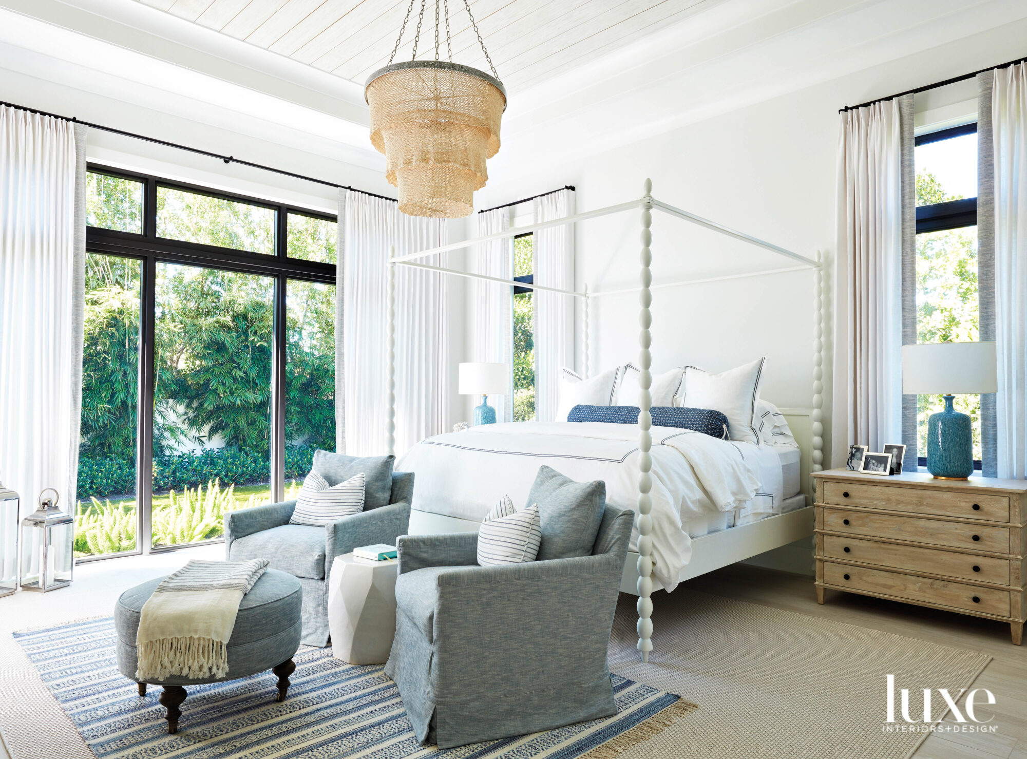 bedroom with white four-poster bed,...