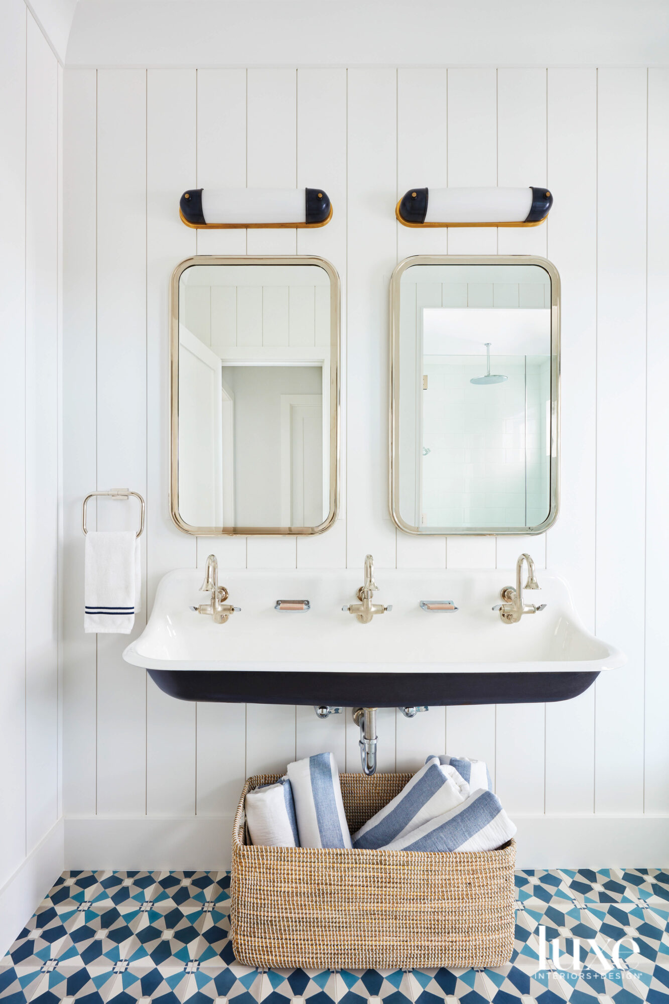 bathroom with white wall, two...