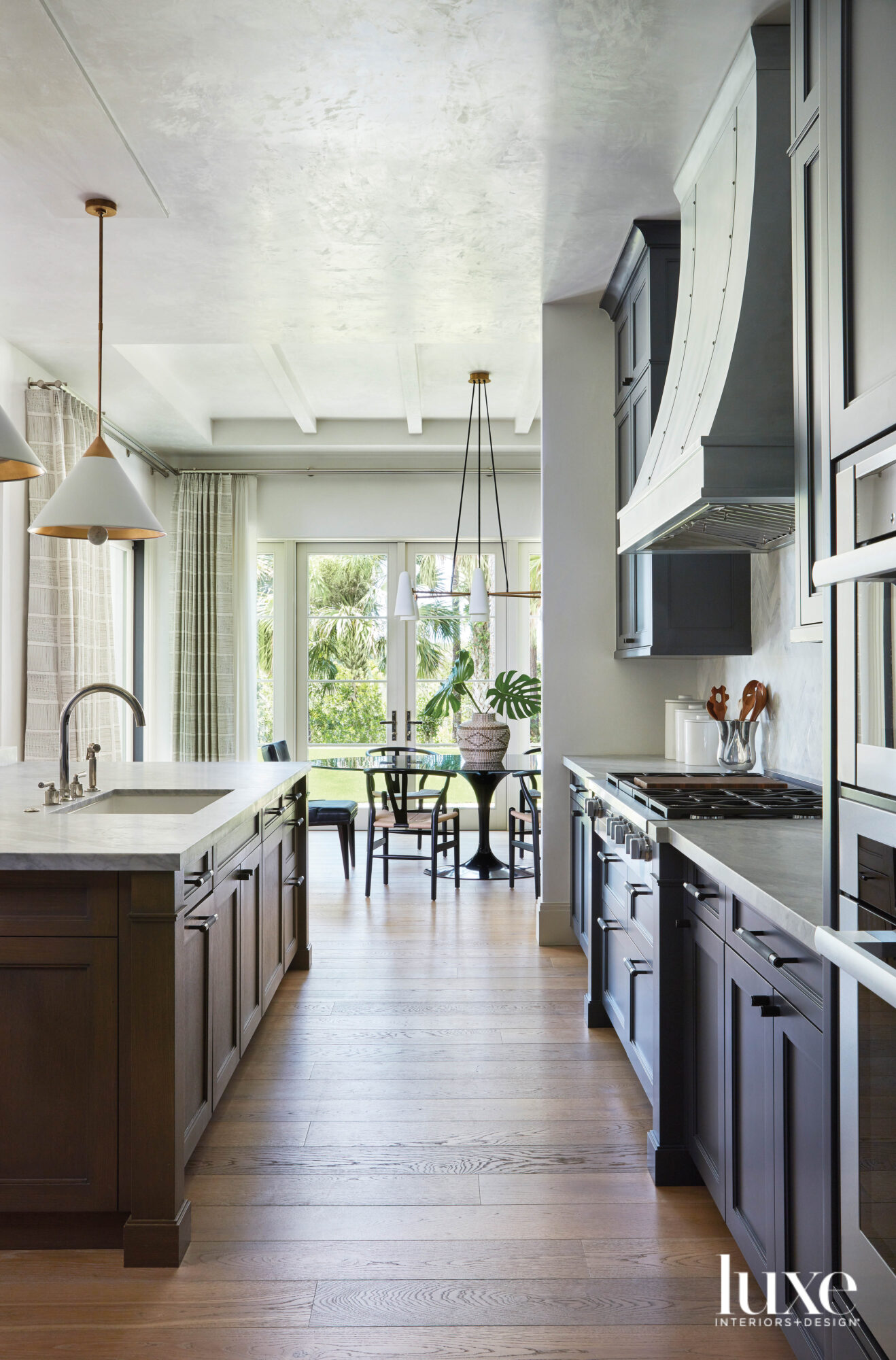 kitchen with gray cabinetry, wood...