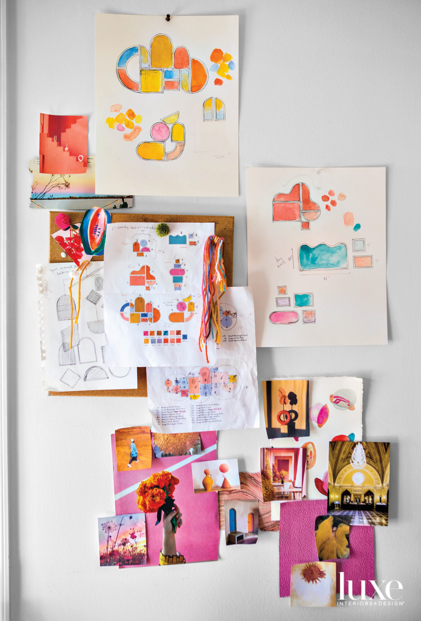a mood board of colorful drawings is displayed on a wall in artist Hayley Sheldon's studio