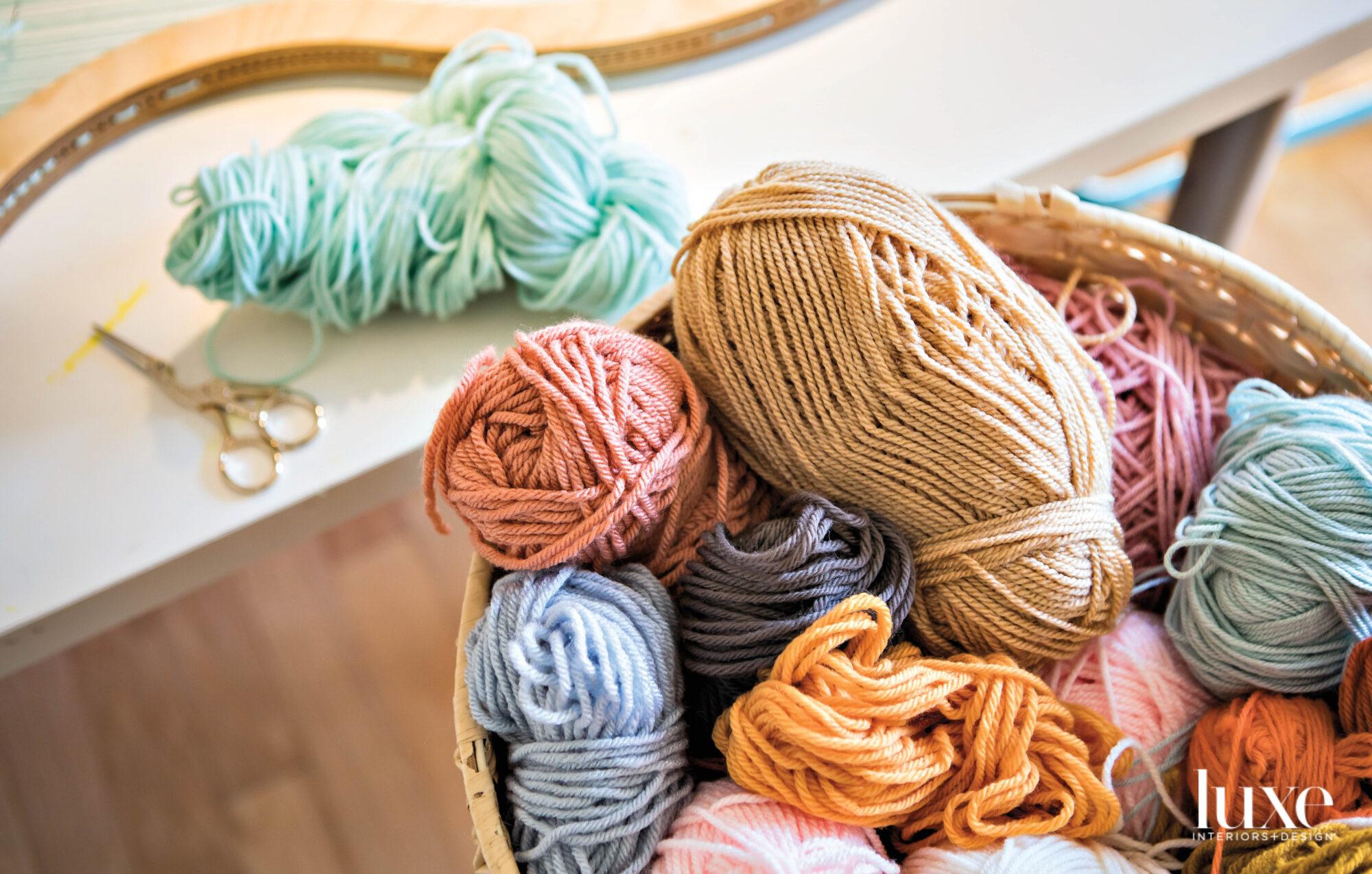 a basket of colorful yarn sits in artist Hayley Sheldon's studio