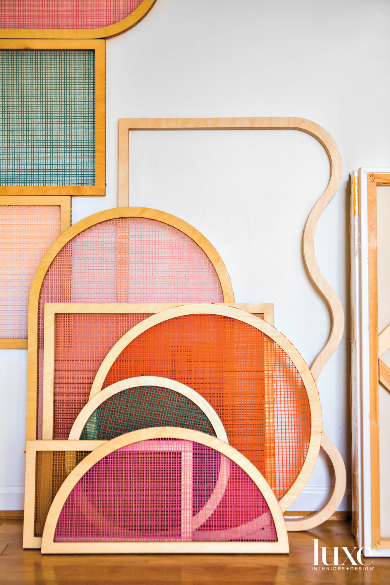 decorative screens by artist Hayley Sheldon are stacked against a wall