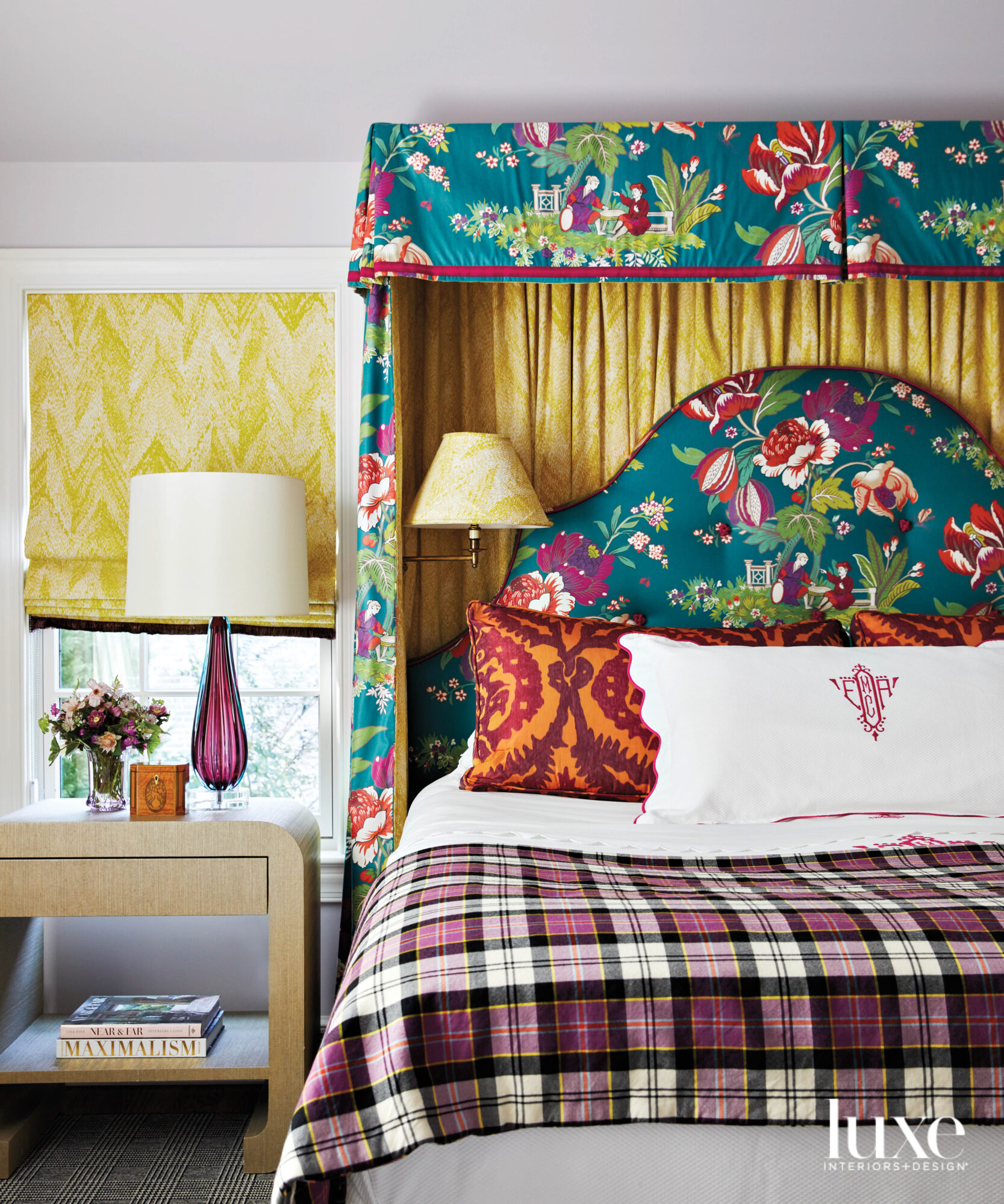 Bed with floral headboard and...