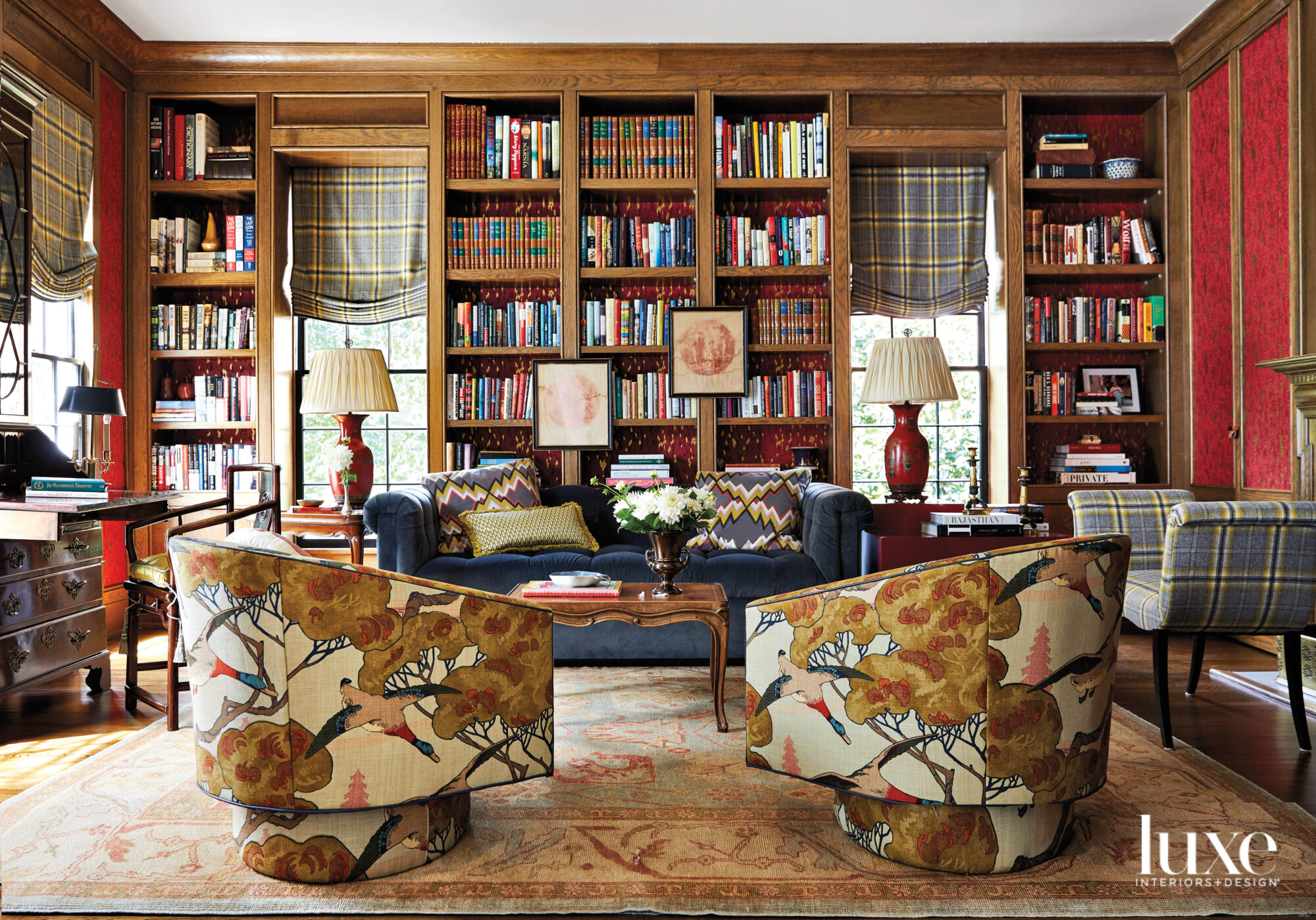 Wood-paneled library with books, swivel...