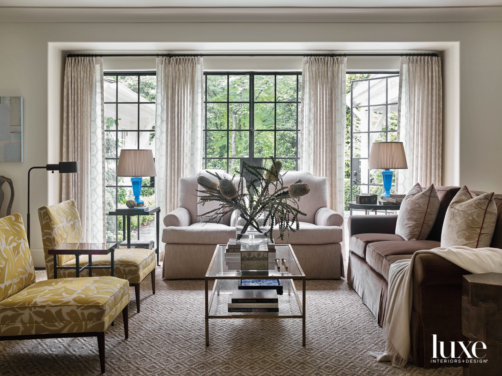Softly sunlit living room with...