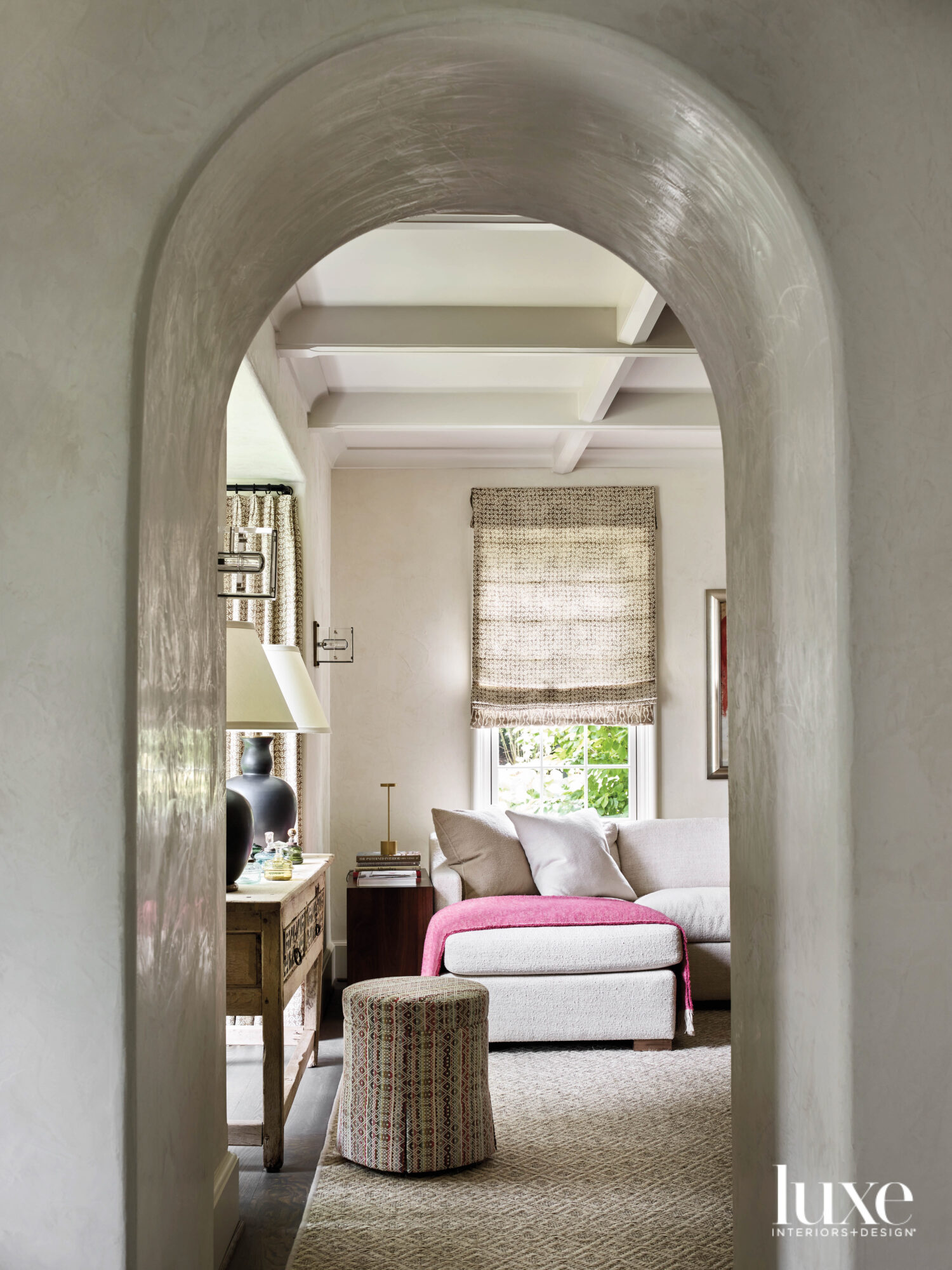 Arched doorway peering into a...
