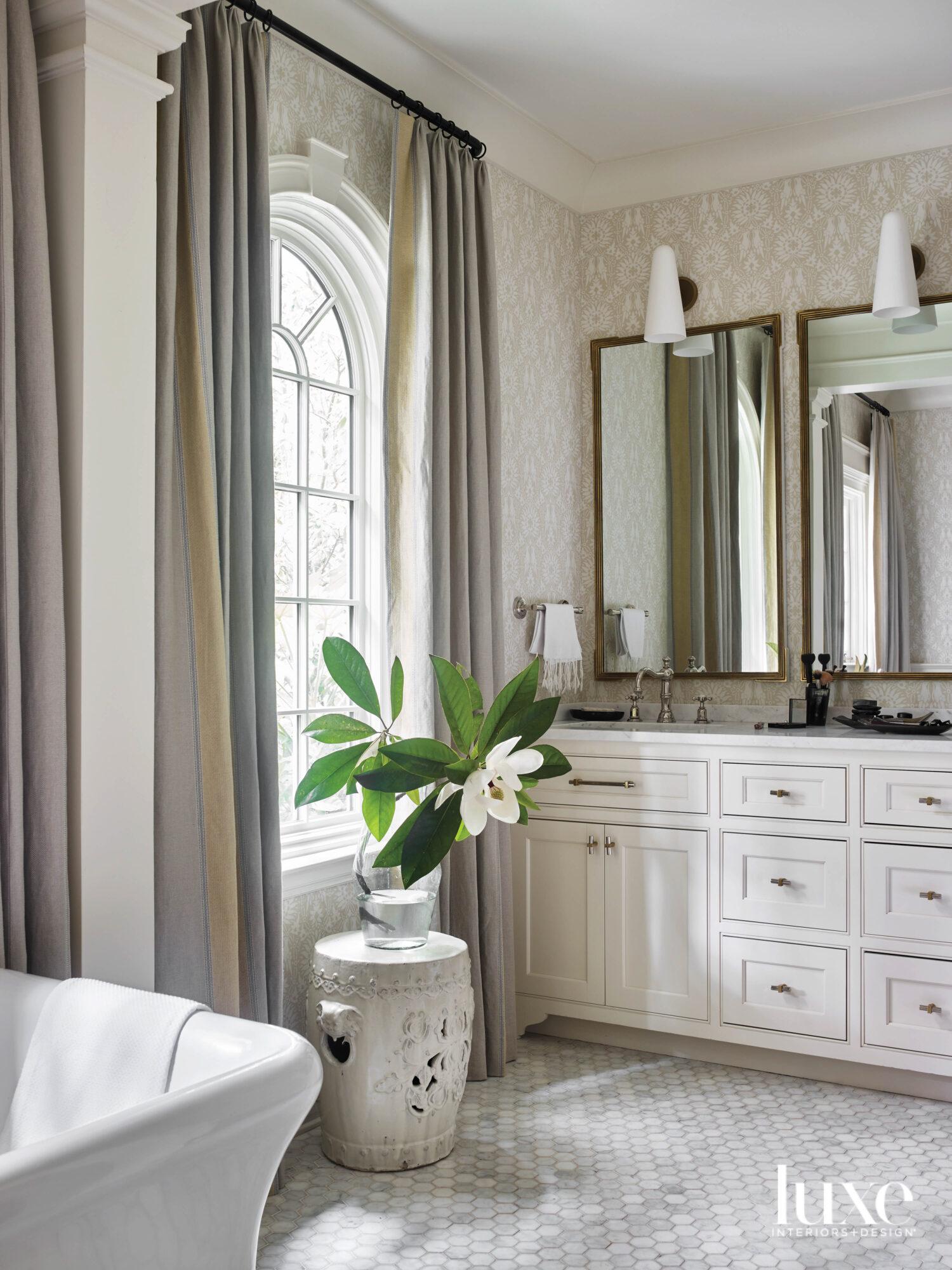Softly lit bathroom with dramatic...