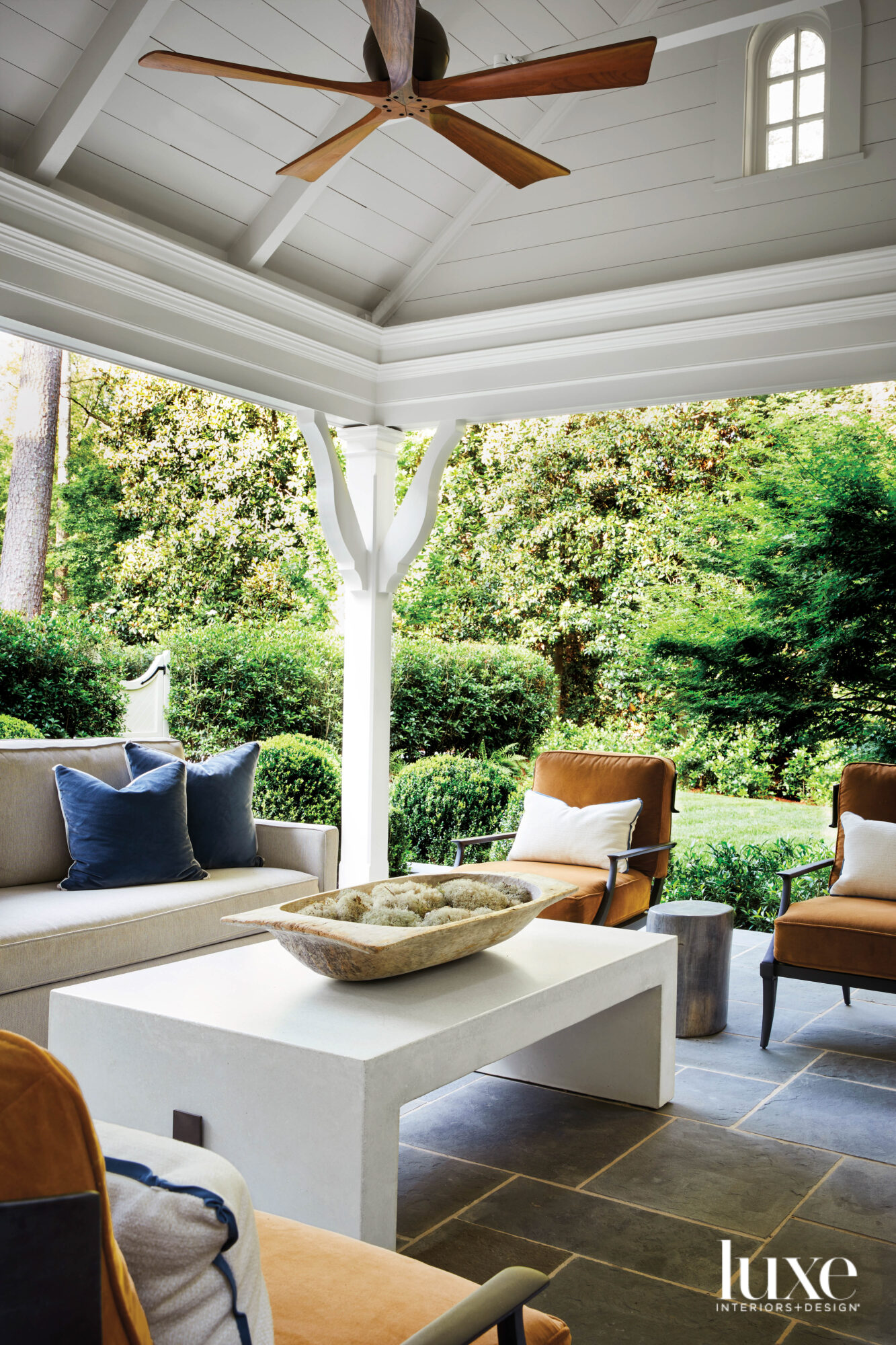 Covered outdoor entertaining area featuring...
