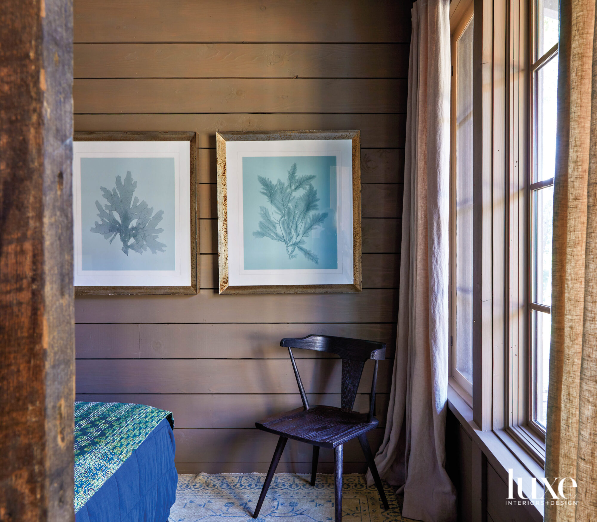 Corner of bedroom with horizontal-paneled...