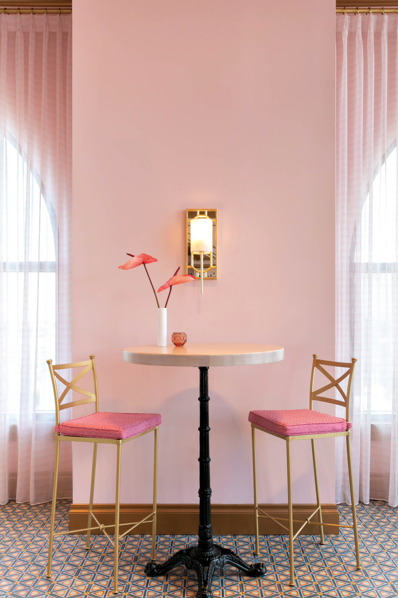 pink high chairs and table