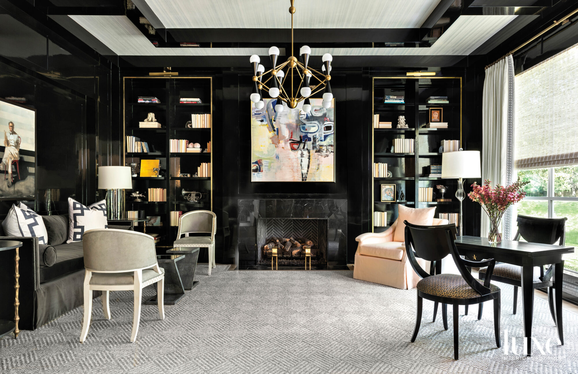 Library featuring a marble fireplace...