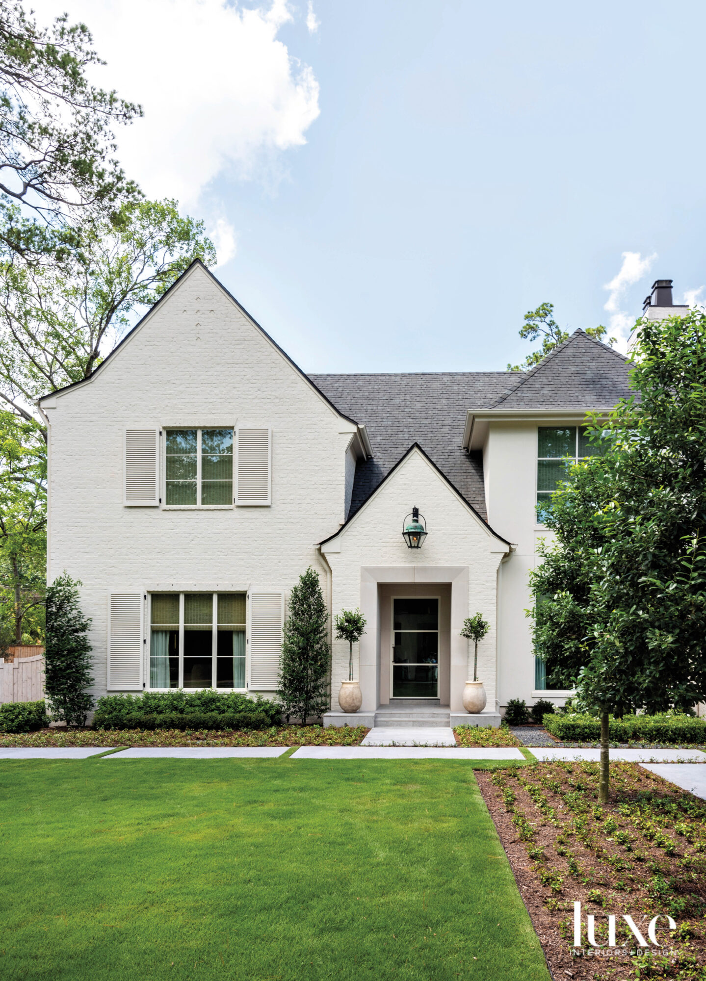 White painted brick home with...