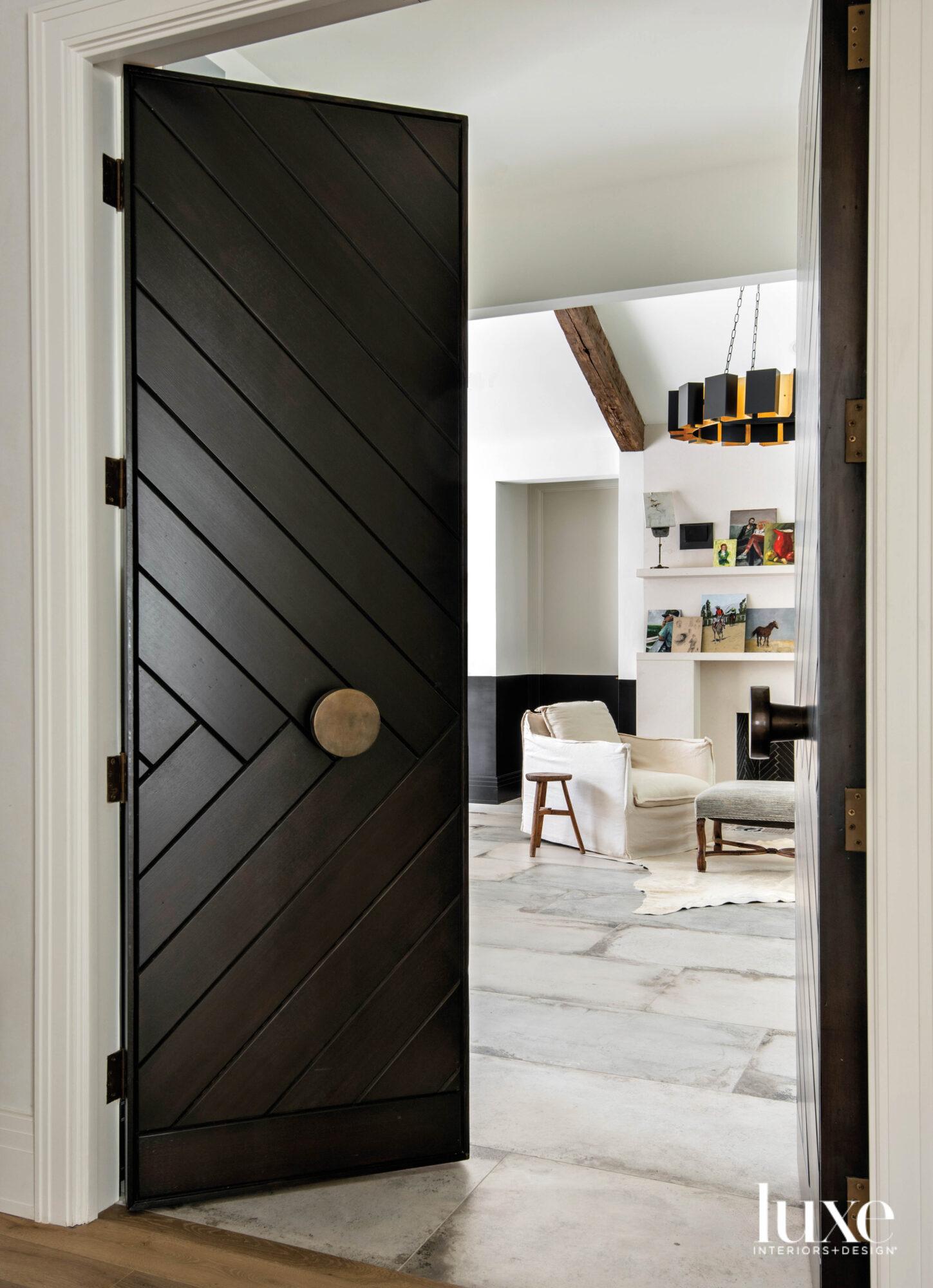 Herringbone patterned doors opening to...