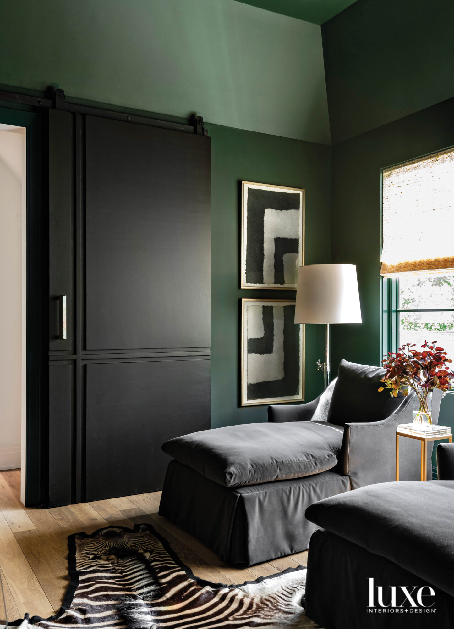 Cozy media room with green...