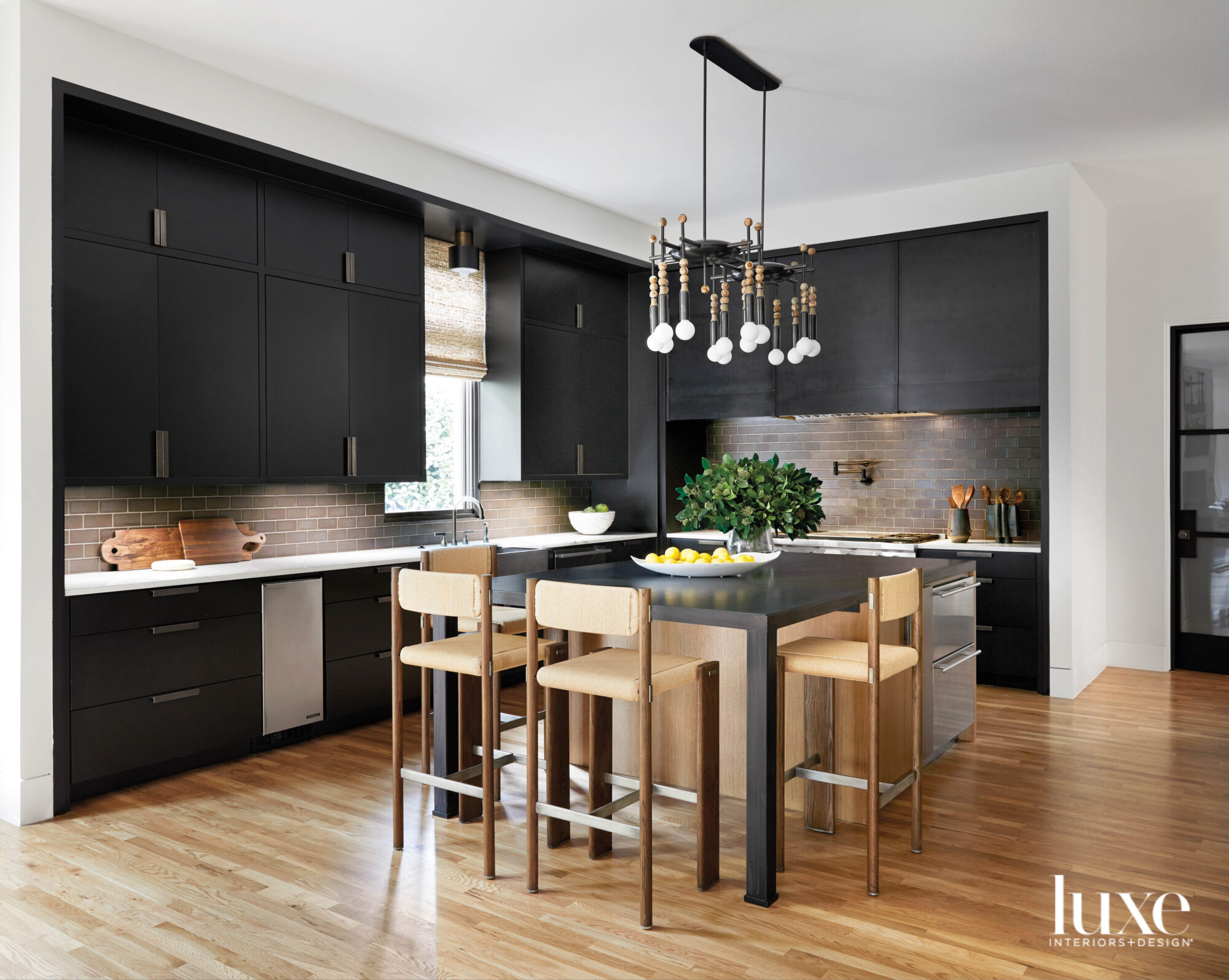 Kitchen with black cabinetry.